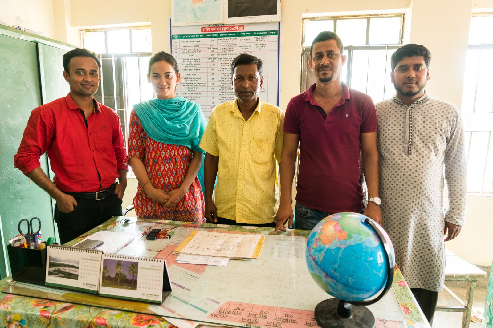 Traveling as a woman in Bangladesh - Posing for a photo with teachers in Hatiya - Lost With Purpose travel blog