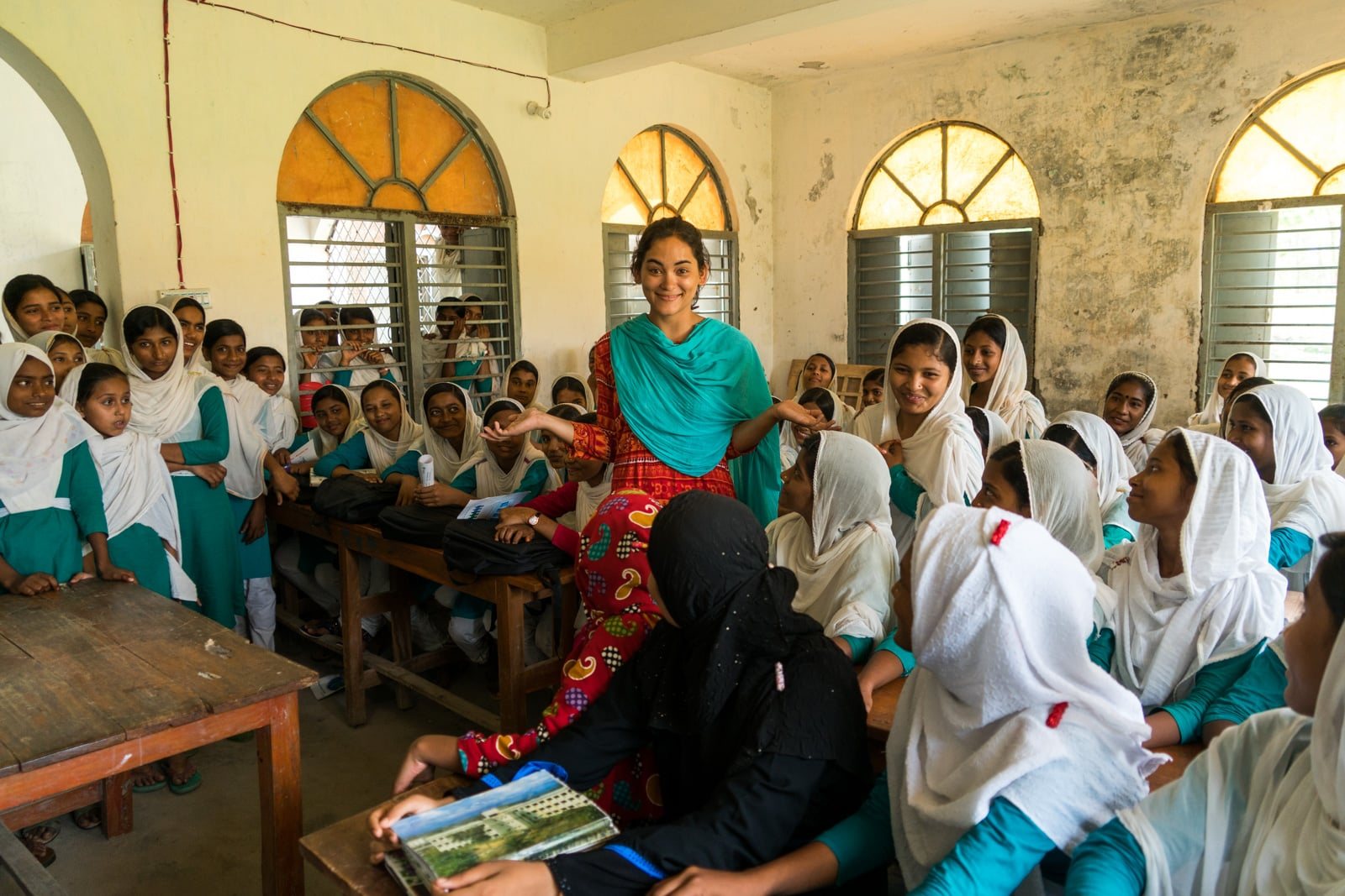What it's like to travel as a woman in Bangladesh - Amongst a crowd of school girls in Manpura, Bangladesh - Lost With Purpose travel blog