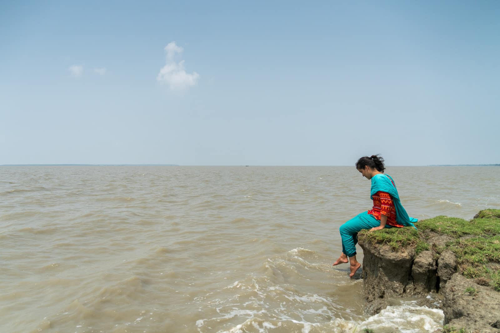 Is Bangladesh safe for solo female travelers - Chilling on the Meghna river bank on Manpura island - Lost With Purpose travel blog