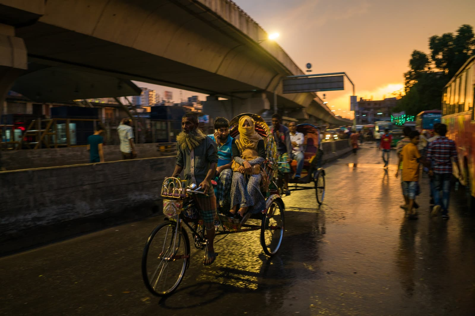 Guide to solo female travel in Bangladesh - Woman and her escort in a rickshaw in Dhaka - Lost With Purpose travel blog