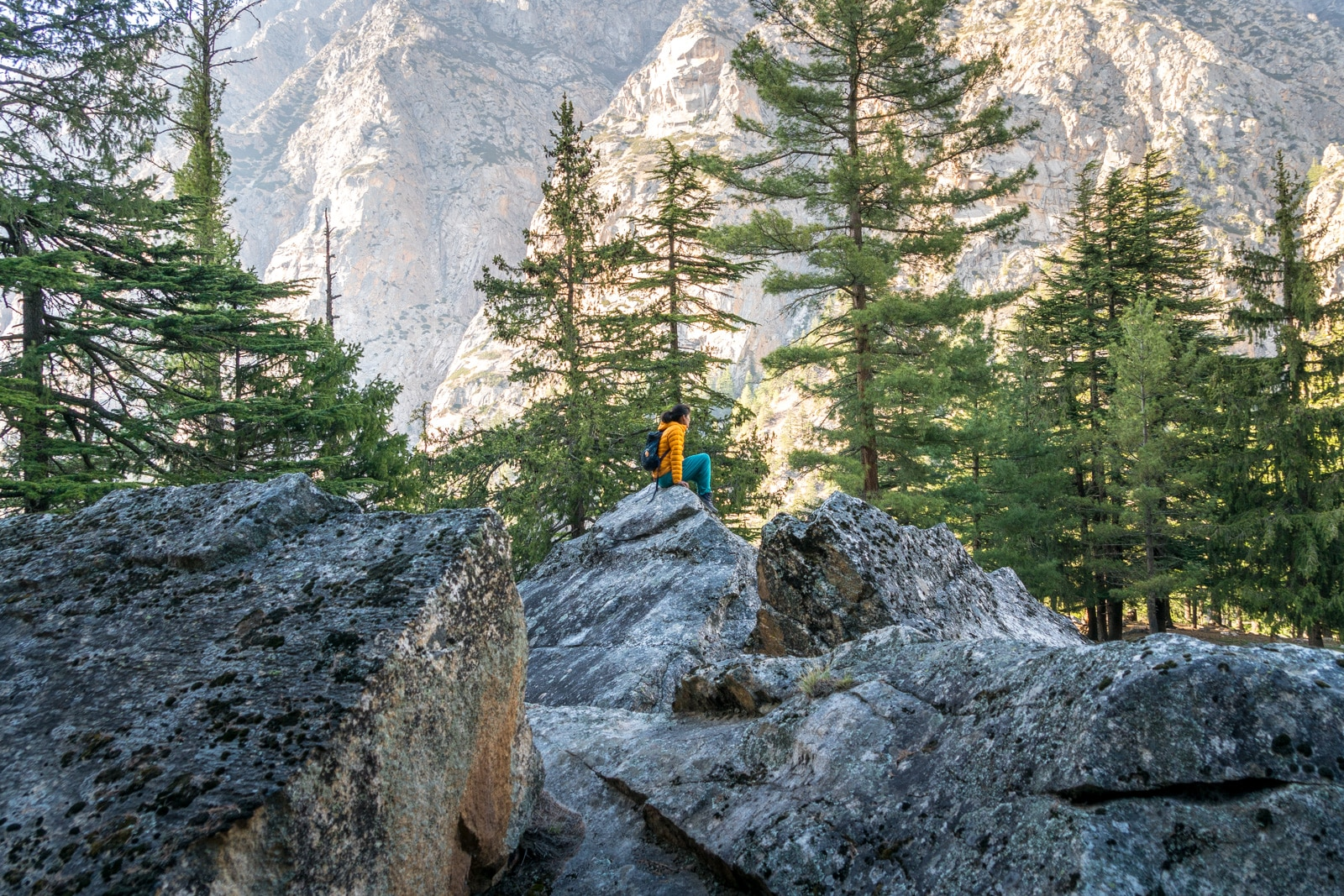 Easy ways to travel more responsibly - Alex on rocks in Gangotri - Lost With Purpose travel blog