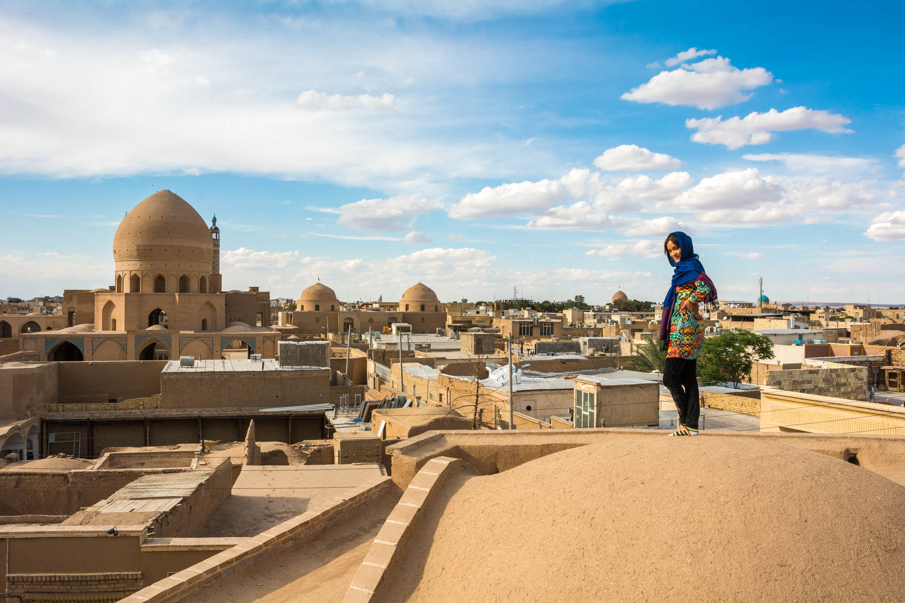 Easy ways to travel more responsibly - Alex in local clothes in Kashan, Iran - Lost With Purpose travel blog