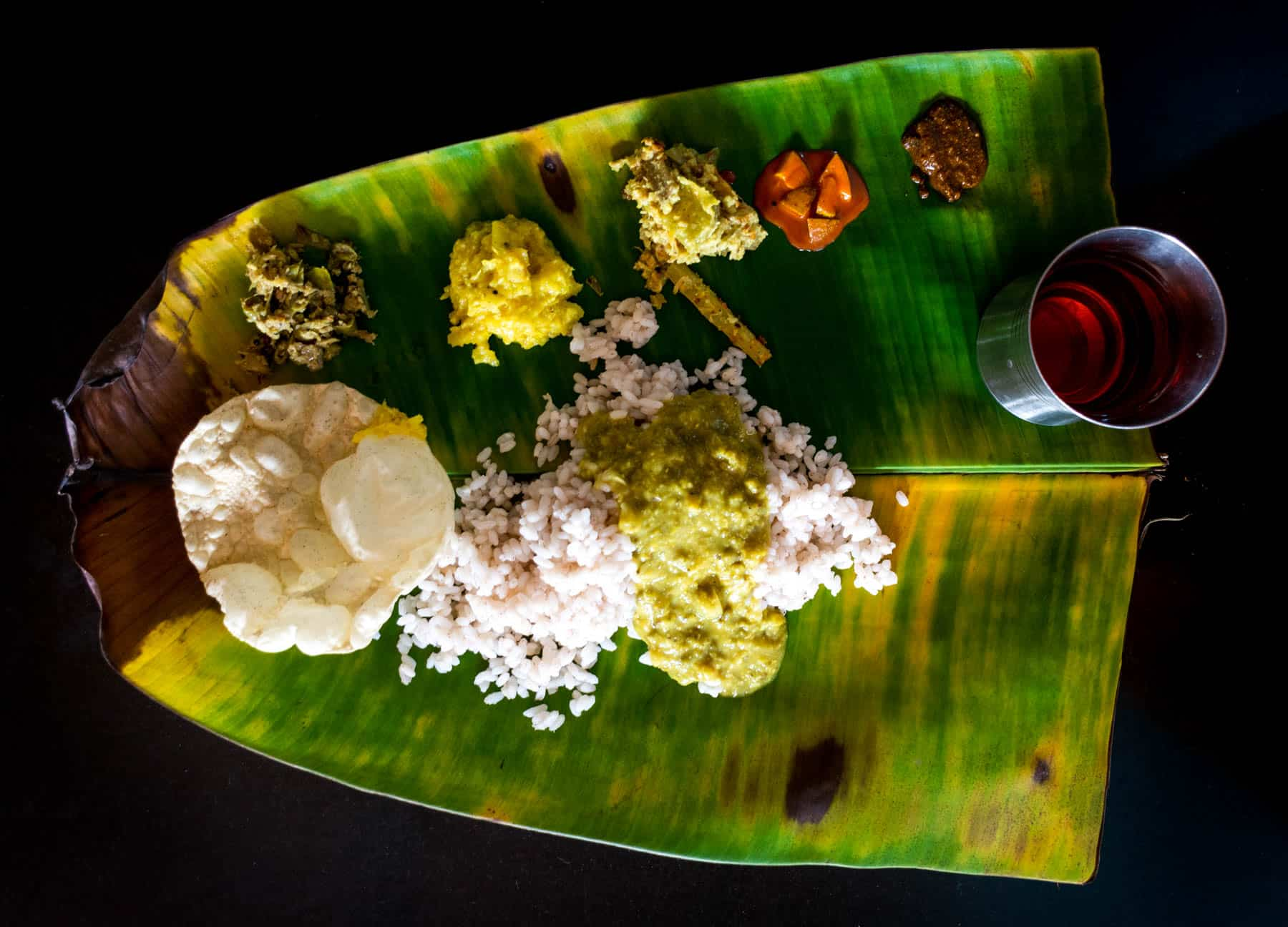 Easy ways to travel more responsibly - South Indian rice thali on a banana leaf - Lost With Purpose travel blog