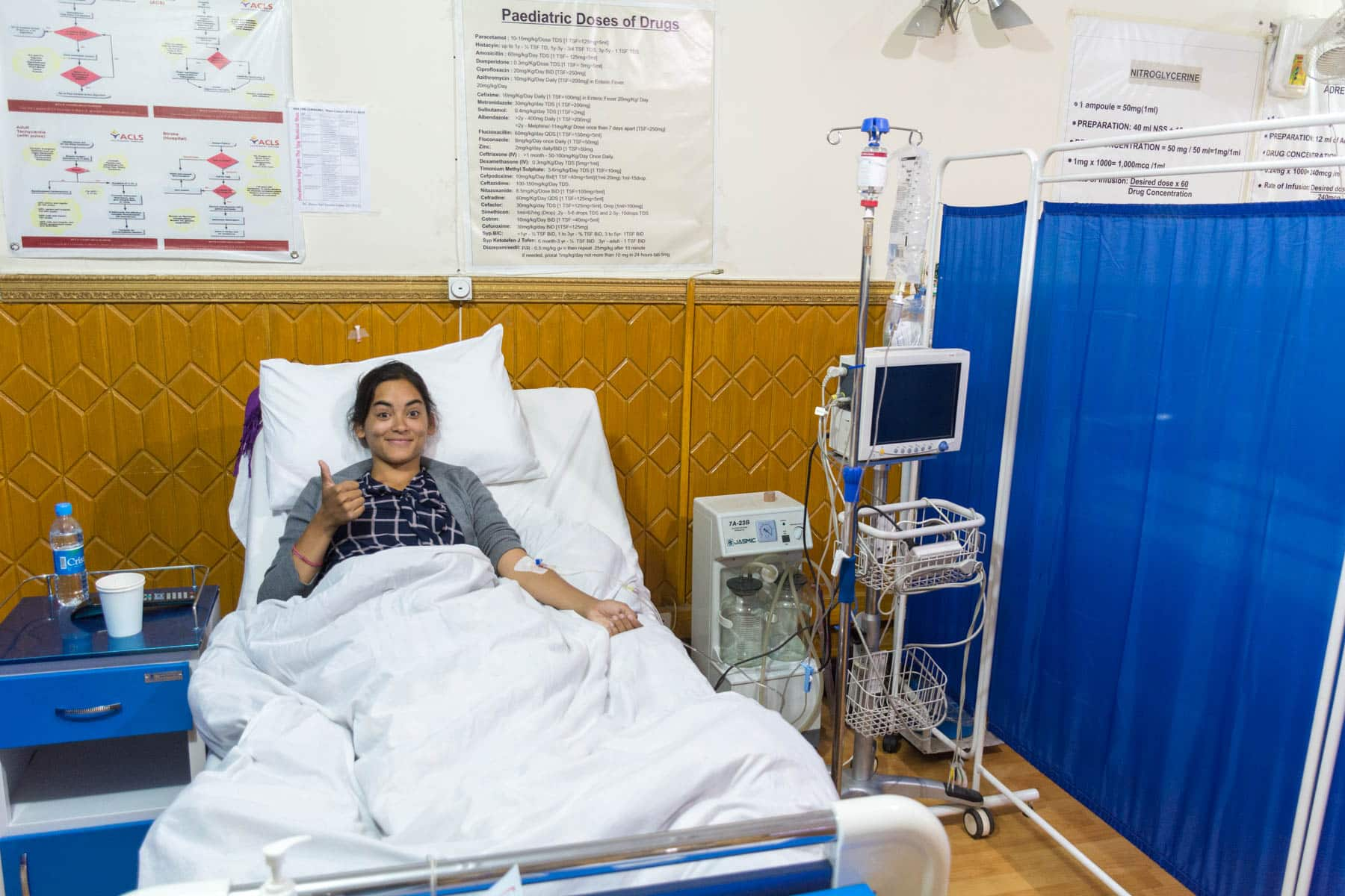 Important things to have in your travel insurance - Alex in a clinic in Kabul, Afghanistan - Lost With Purpose travel blog