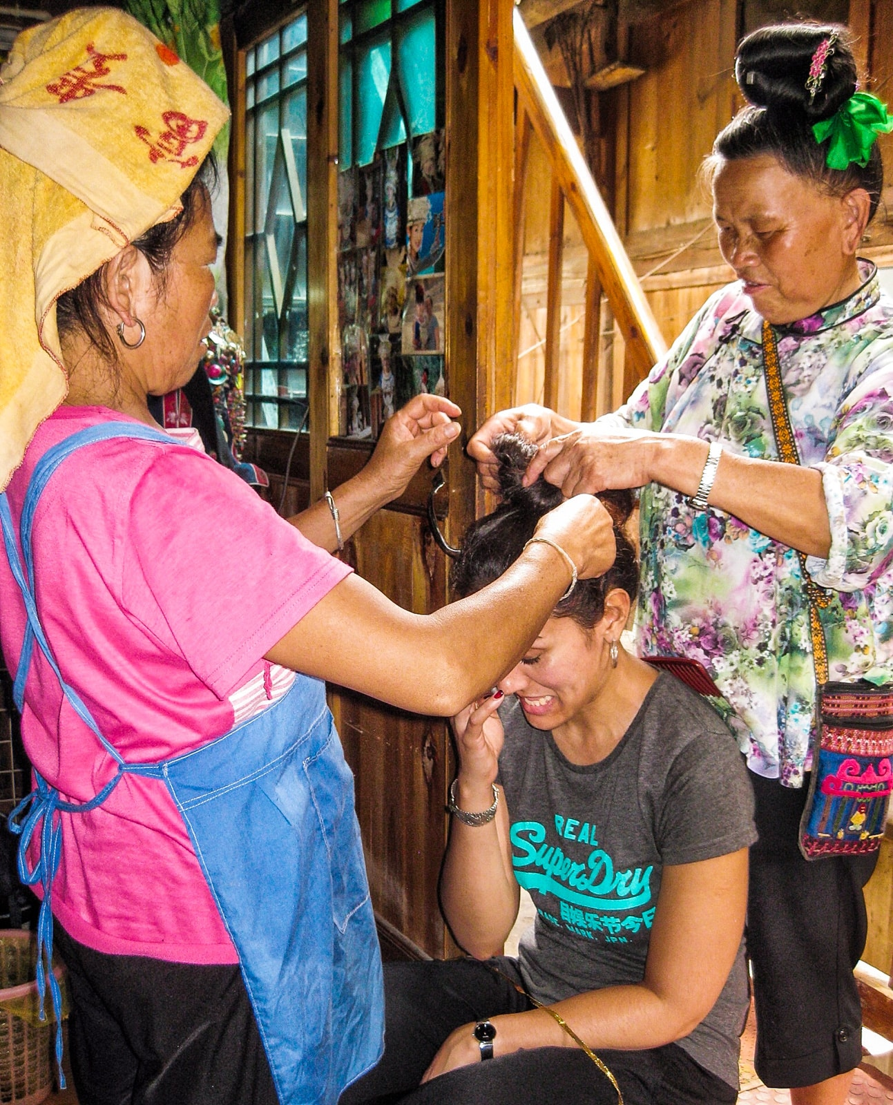 Exploring off the beaten track villages in Guizhou, China - Hair done by ladies in Langde