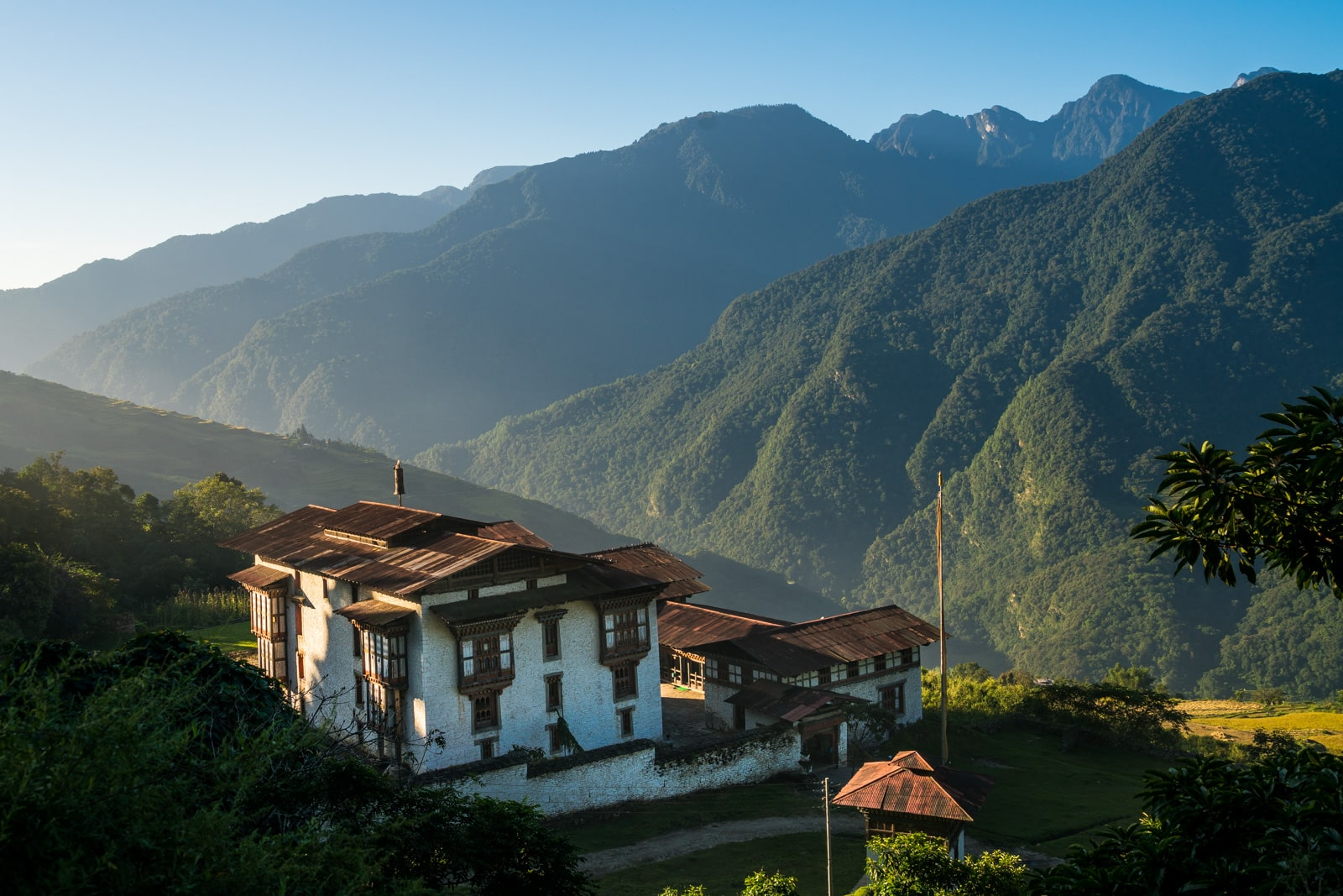 Stunning photos of Bhutan - Kuengarabten dzong at sunrise - Lost With Purpose travel blog