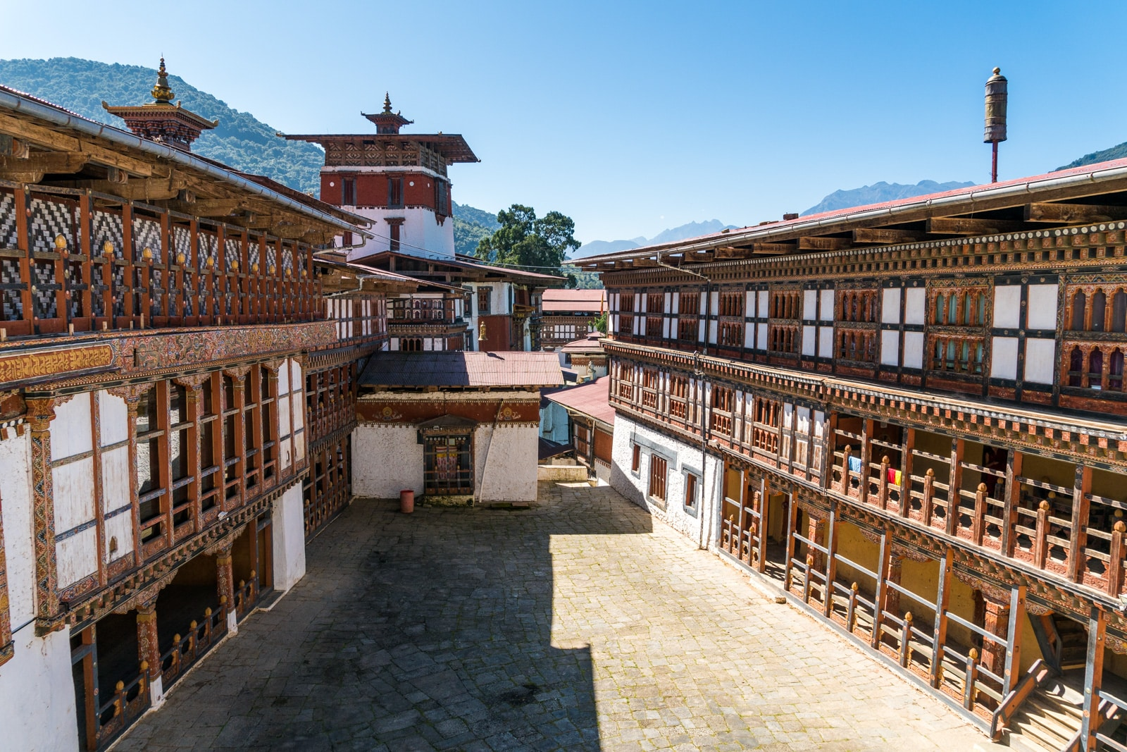 Stunning photos of Bhutan - Trongsa dzong interior with blue sky - Lost With Purpose travel blog
