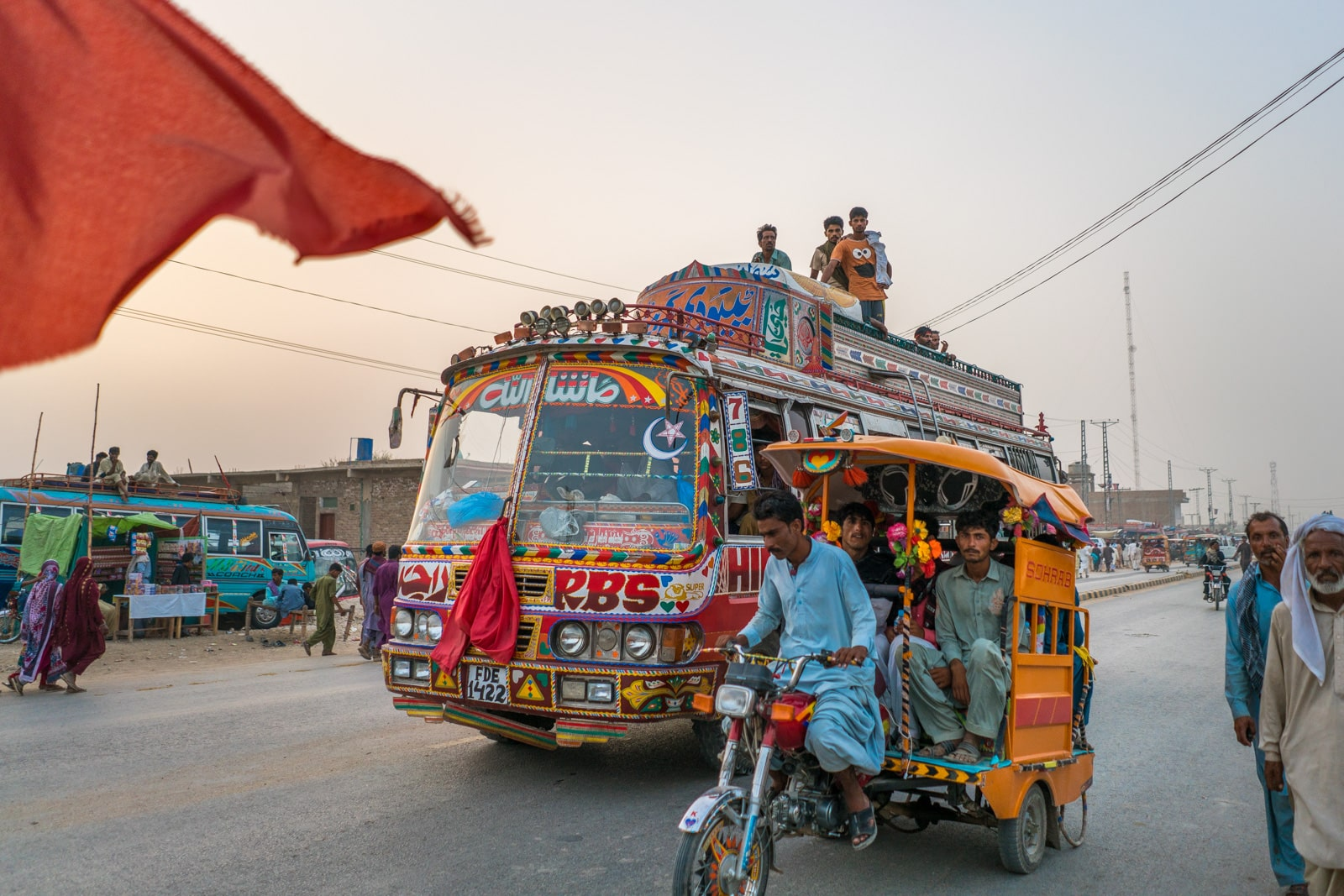 A rickshaw and a local bus transporting people in Pakistan