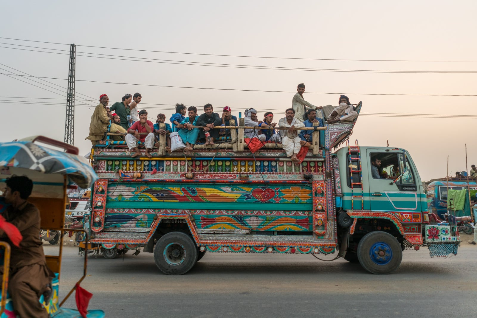 The Urs of Lal Shahbaz Qalandar in Sehwan, Pakistan - Colorful Pakistani truck full of men - Lost With Purpose travel blog