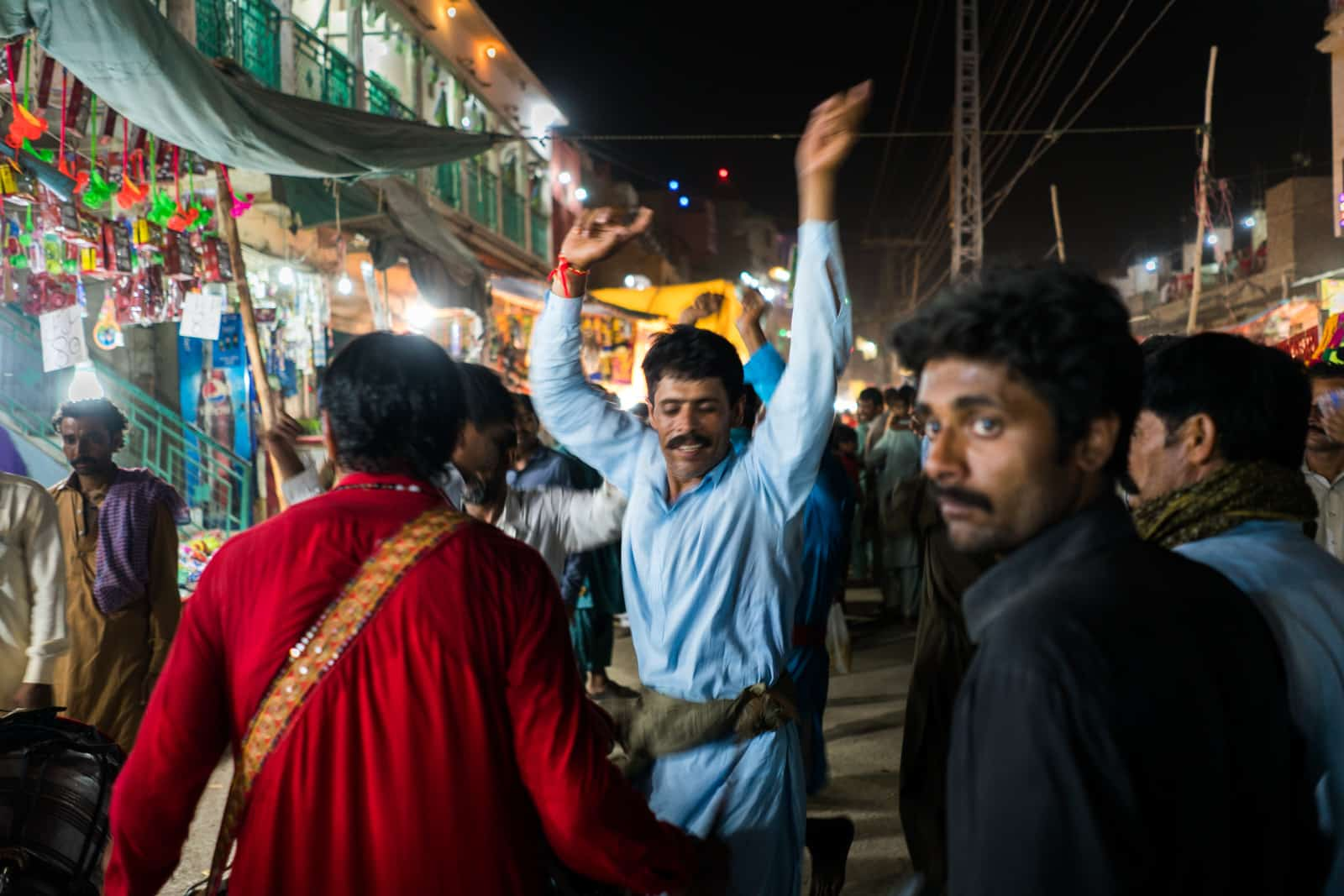 The Urs of Lal Shahbaz Qalandar in Sehwan, Pakistan - Man dancing on the streets of Sehwan at night - Lost With Purpose travel blog