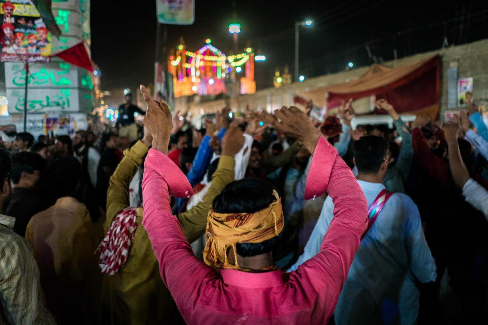 The Urs of Lal Shahbaz Qalandar in Sehwan, Pakistan - People dancing on the streets of Sehwan at night - Lost WIth Purpose travel blog