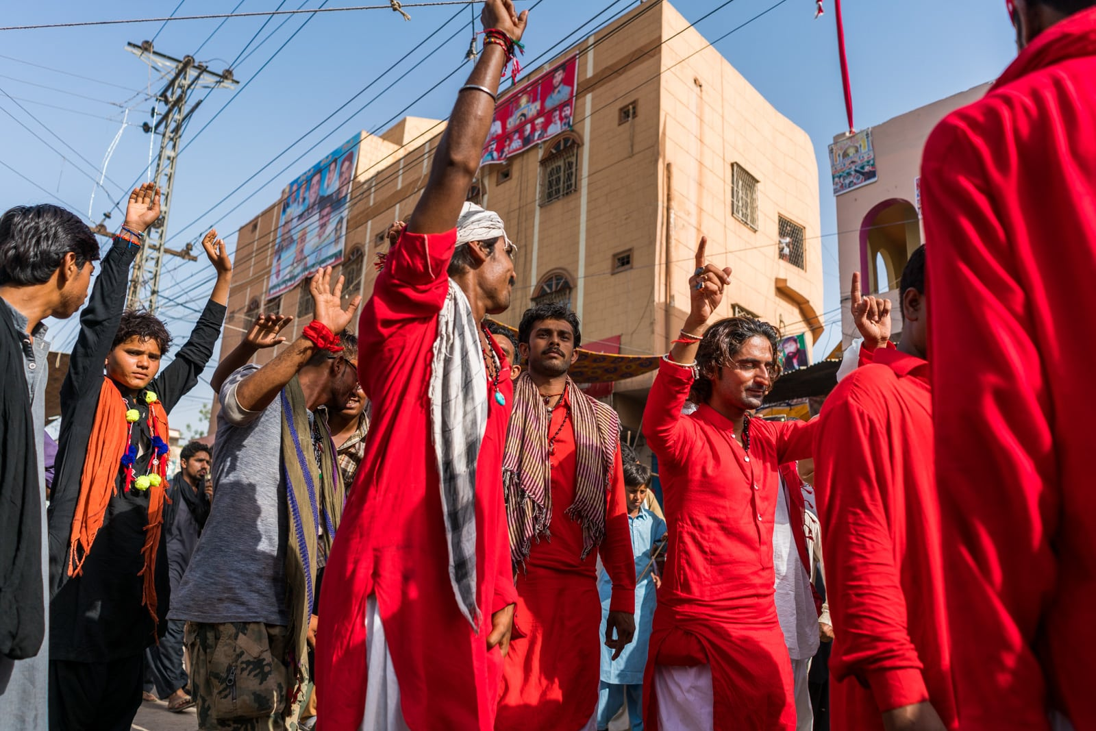 The Urs of Lal Shahbaz Qalandar in Sehwan, Pakistan - Sufi men in red dancing on the streets - Lost With Purpose travel blog