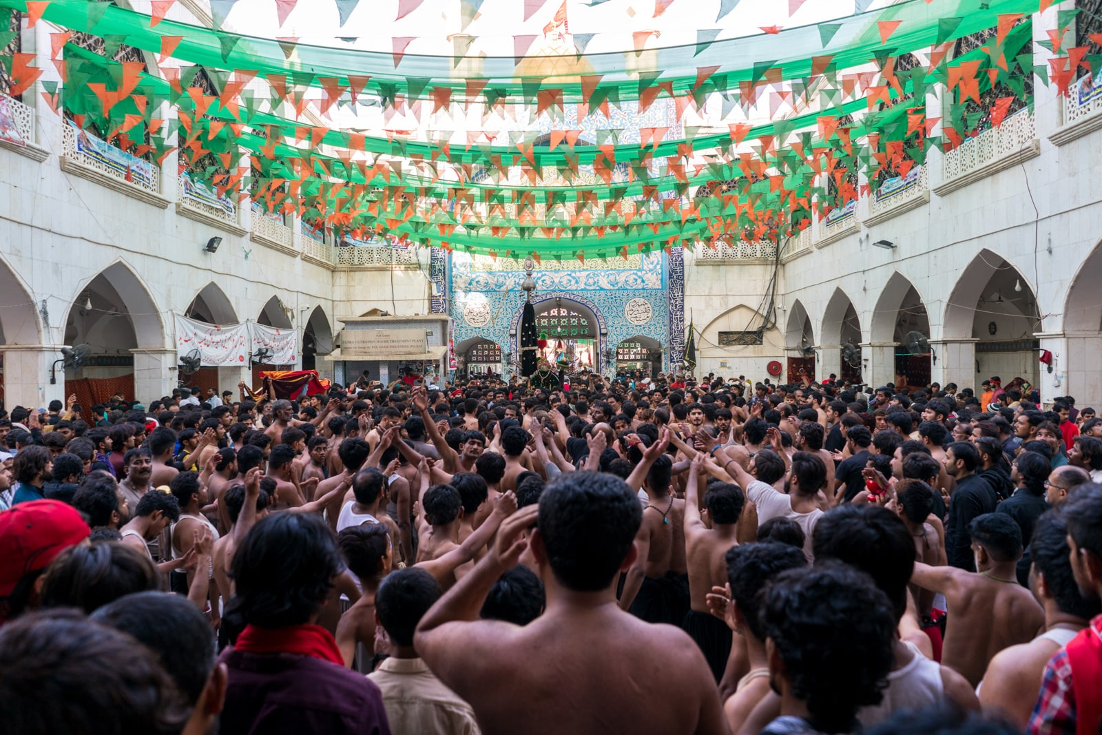 The Urs of Lal Shahbaz Qalandar in Sehwan, Pakistan - Crowd of Shias doing self flagellation outside the shrine - Lost With Purpose travel blog