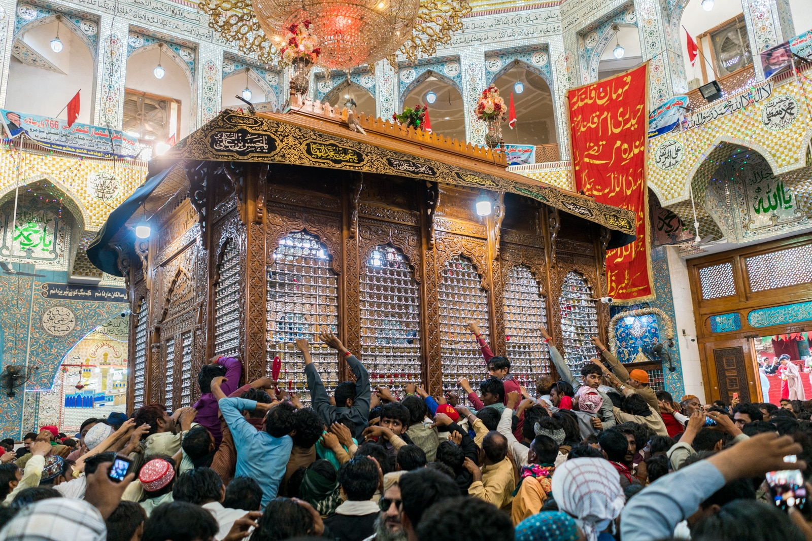 The Urs of Lal Shahbaz Qalandar in Sehwan, Pakistan - Devotees trying to touch the shrine - Lost With Purpose travel blog