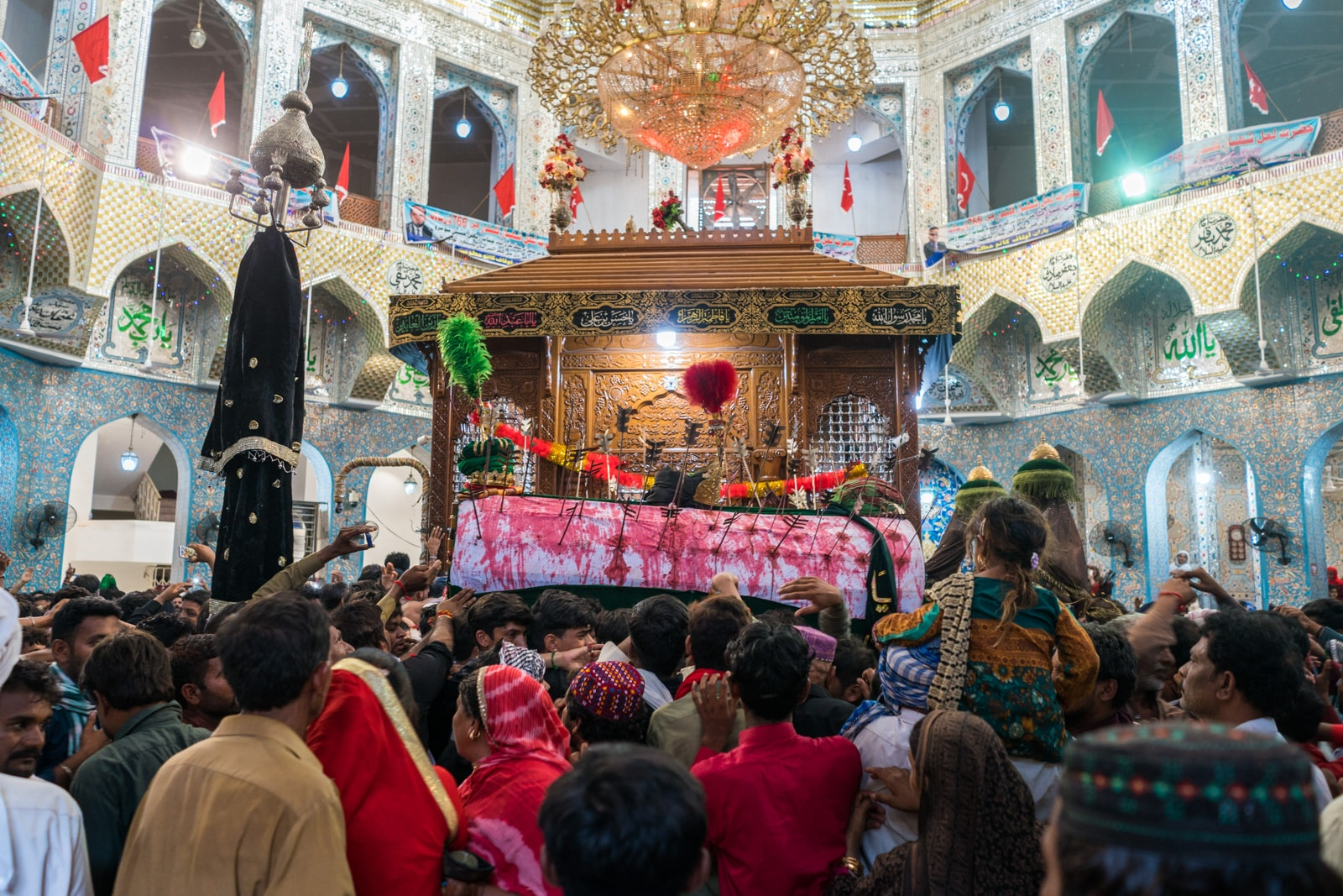 The Urs of Lal Shahbaz Qalandar in Sehwan, Pakistan - Shia coffin circling the tomb - Lost With Purpose travel blog