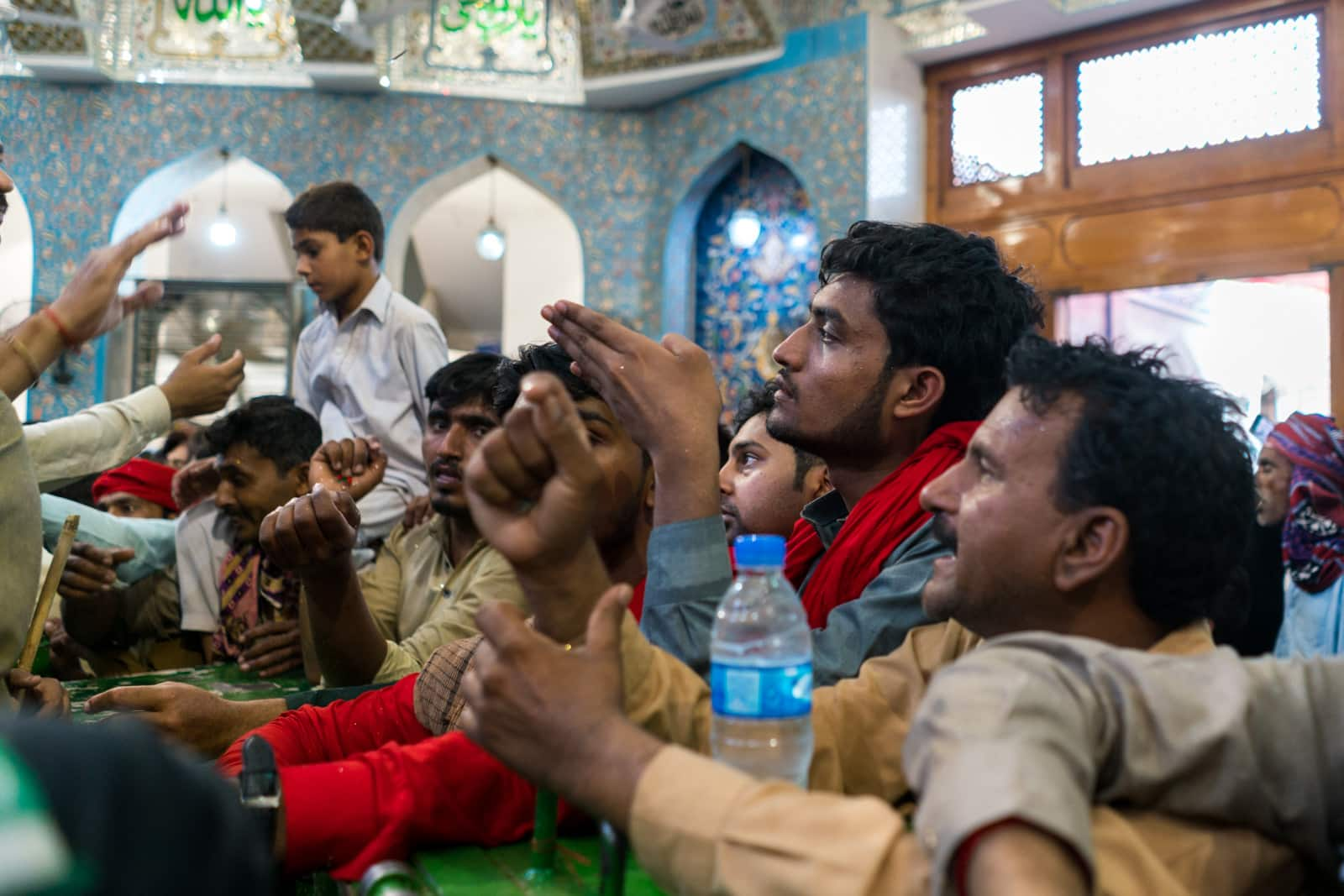 The Urs of Lal Shahbaz Qalandar in Sehwan, Pakistan - Devotees praying at the tomb - Lost With Purpose travel blog