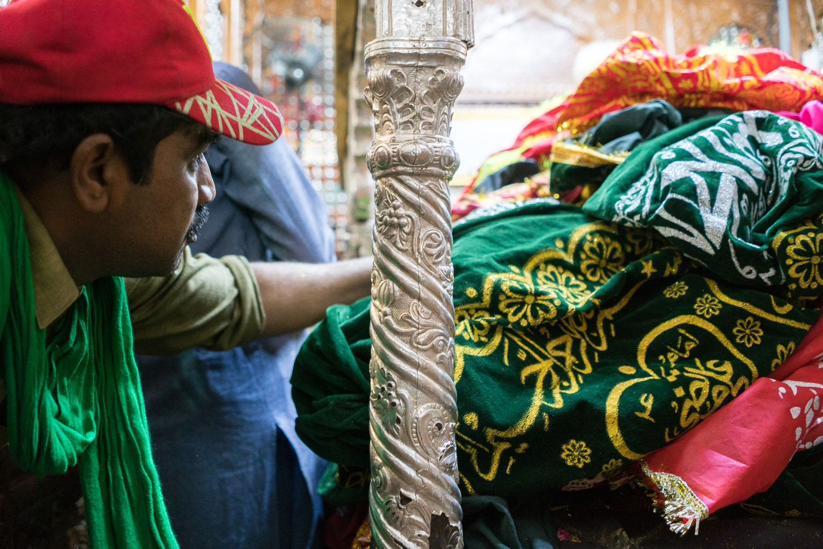 The Urs of Lal Shahbaz Qalandar in Sehwan, Pakistan - Man touching tomb - Lost With Purpose travel blog
