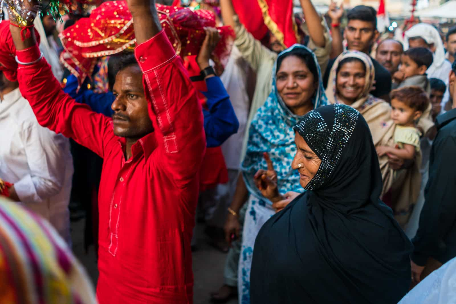 The Urs of Lal Shahbaz Qalandar in Sehwan, Pakistan - Woman in the crowd - Lost With Purpose travel blog