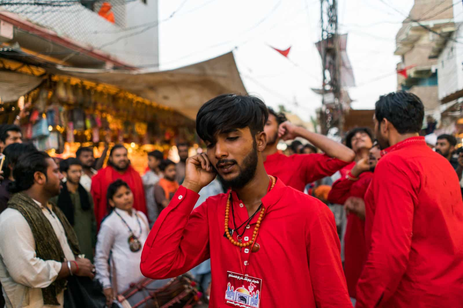 The Urs of Lal Shahbaz Qalandar in Sehwan, Pakistan - Boy in red dancing outside shrine - Lost With Purpose travel blog