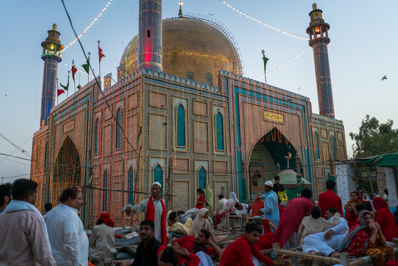 The Urs of Lal Shahbaz Qalandar in Sehwan, Pakistan - Crowds watching the dhamaal from a rooftop near the shrine - Lost With Purpose travel blog