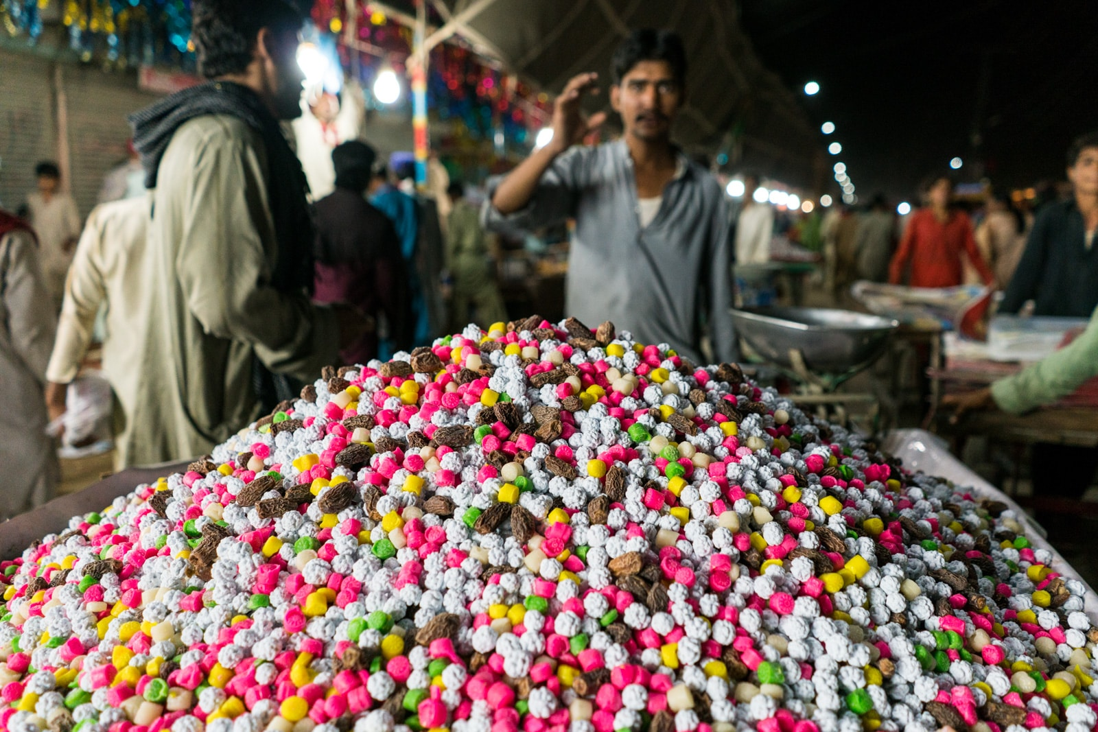The Urs of Lal Shahbaz Qalandar in Sehwan, Pakistan - Cart of sweets for handouts in the shrine - Lost With Purpose travel blog
