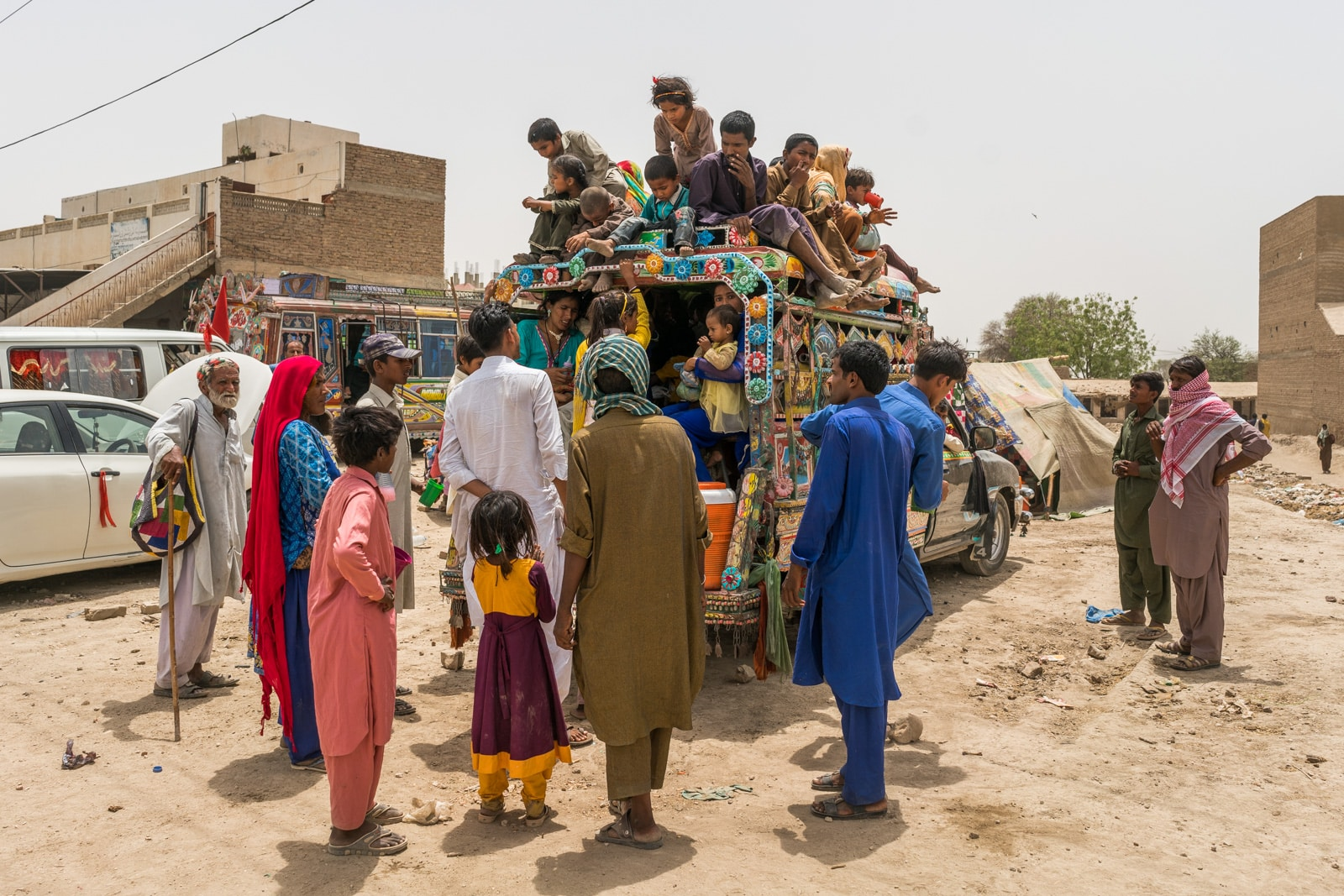 The Urs of Lal Shahbaz Qalandar in Sehwan, Pakistan - Family squishing onto a bus - Lost With Purpose travel blog