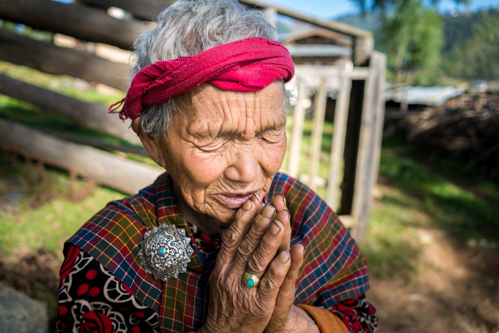 Stunning photos of Bhutan - Grandmother praying in Phobjikha Valley - Lost With Purpose travel blog