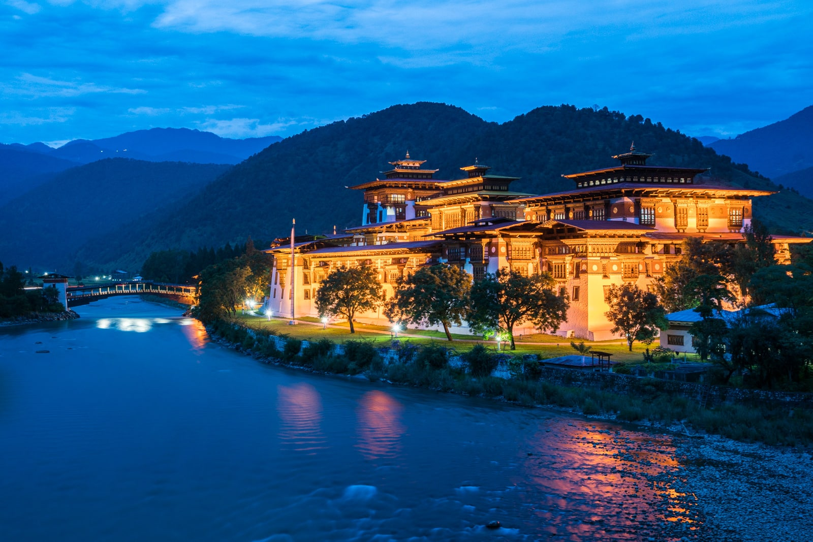 Photos of Bhutan - Punakha dzong lit up at night - Lost With Purpose travel blog