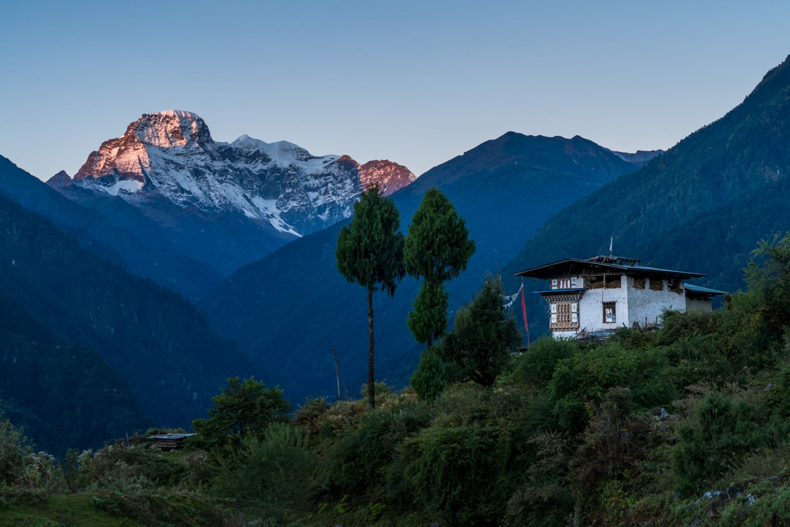Stunning photos of Bhutan - Sunrise over mountains overlooking Gasa - Lost With Purpose travel blog