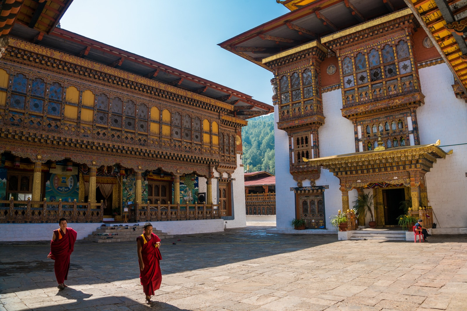 Photos of Bhutan - Monks walking inside Punakha dzong - Lost WIth Purpose travel blog