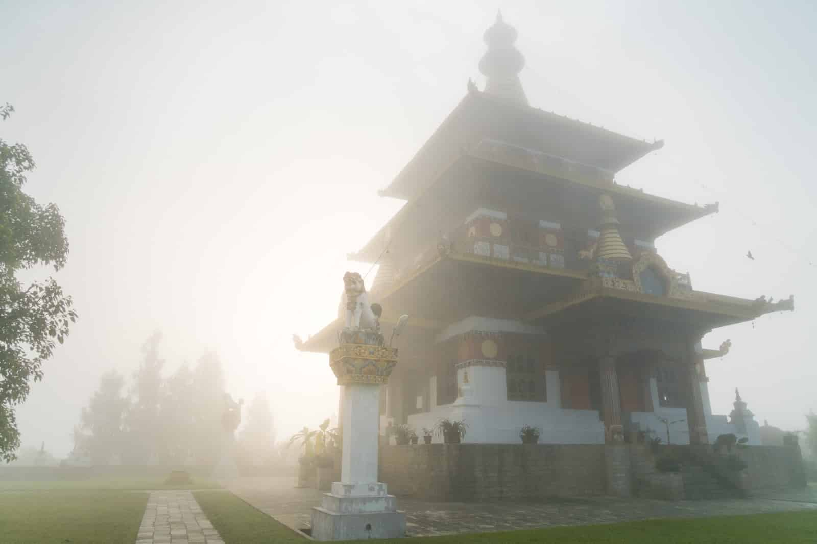 Photos of Bhutan - Fog over Khamsum Yulley Namgyal Chorten near Punakha - Lost With Purpose travel blog