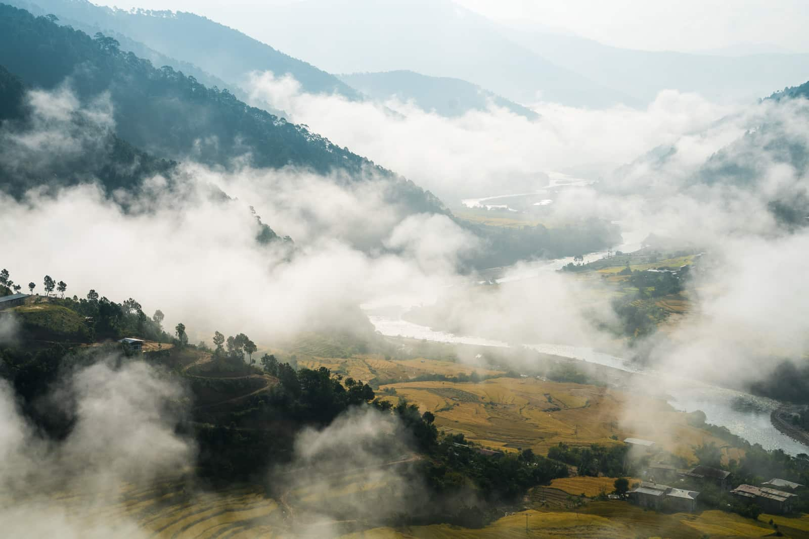 Photos of Bhutan - Rolling mist in a valley near Punakha - Lost With Purpose travel blog