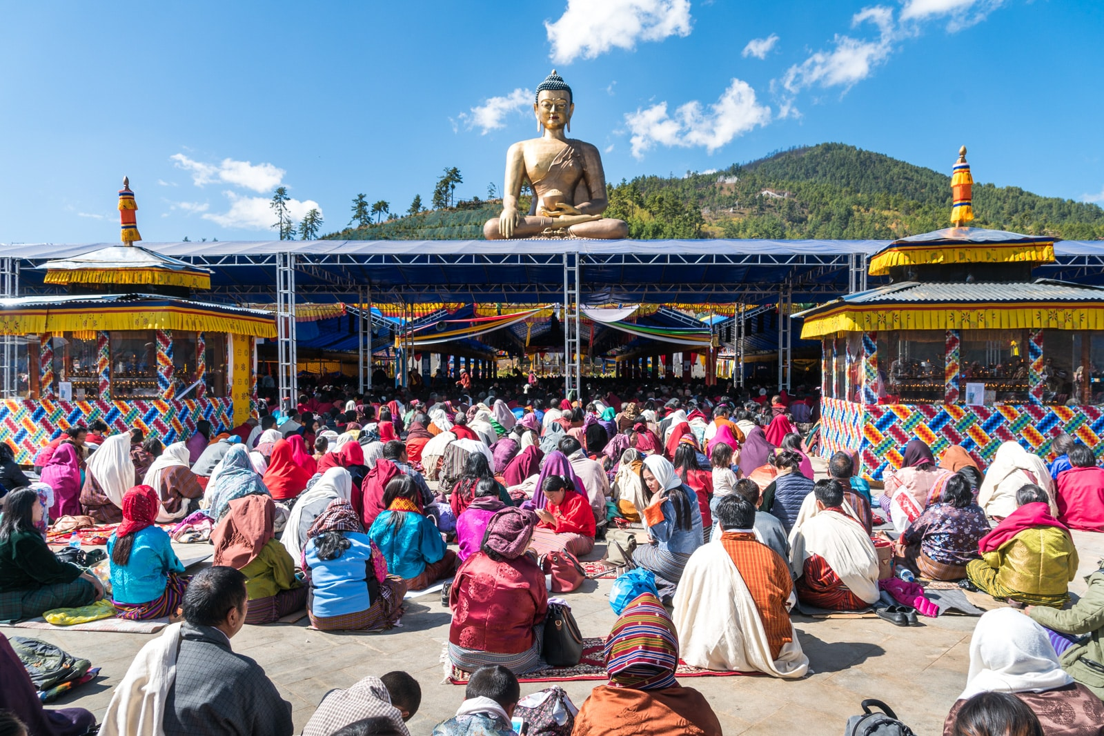 Photos of Bhutan - Devotees sitting at a talk at Buddha Point in Thimphu - Lost With Purpose travel blog