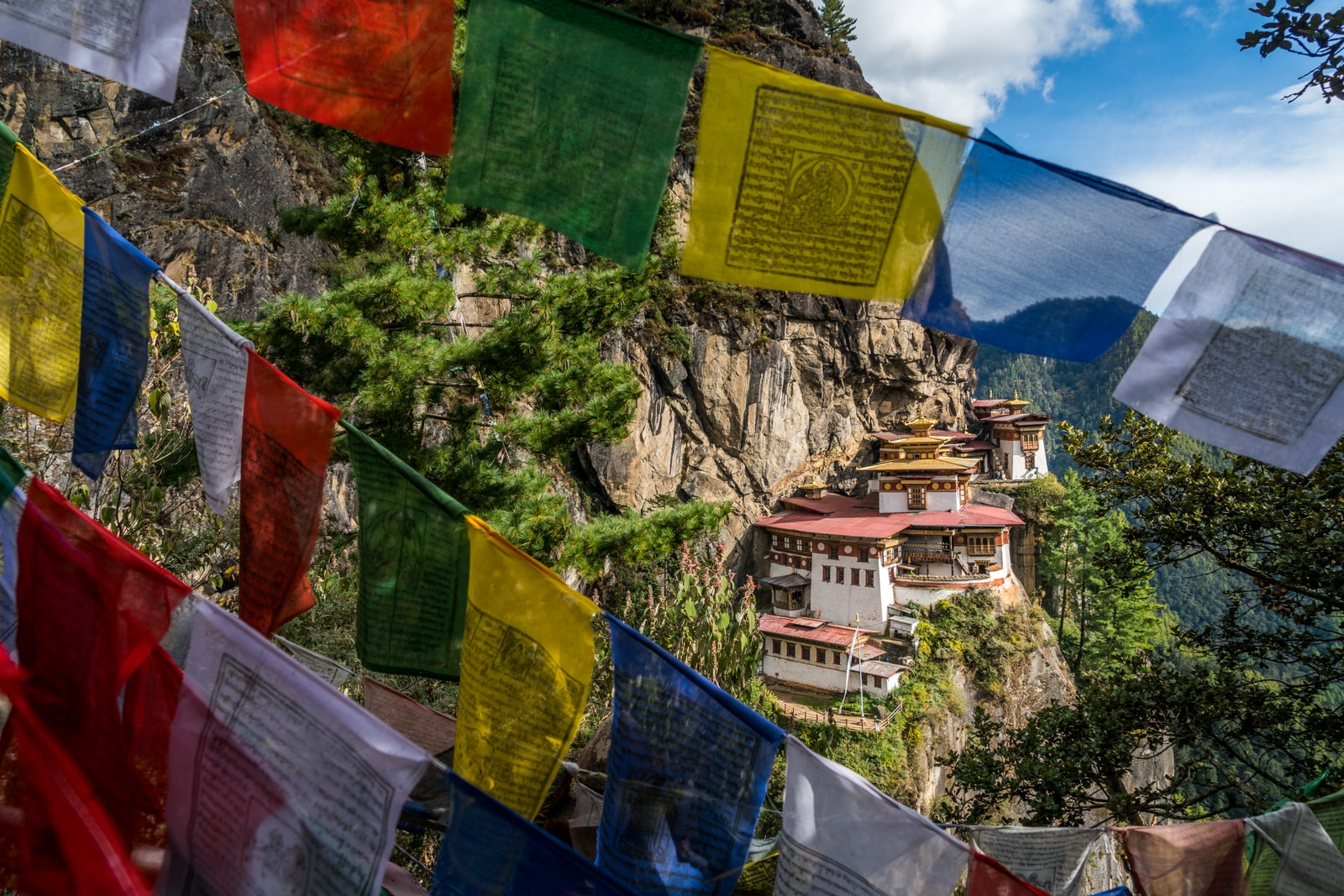 Photos of Bhutan - Tiger's Nest Monastery behind prayer flags - Lost With Purpose travel blog