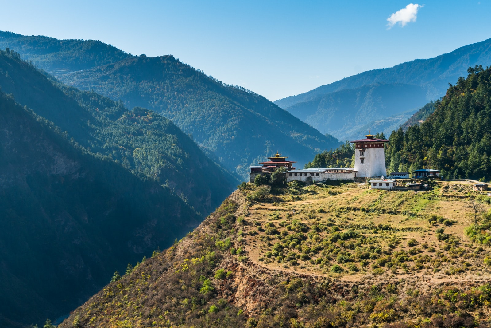 Photos of Bhutan - Dzong on a hill on the way to Haa Valley - Lost With Purpose travel blog