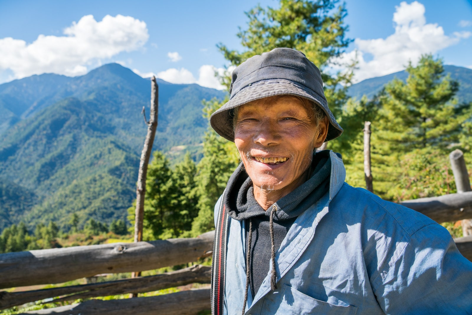 Photos of Bhutan - Jolly man on the side of the road - Lost With Purpose travel blog