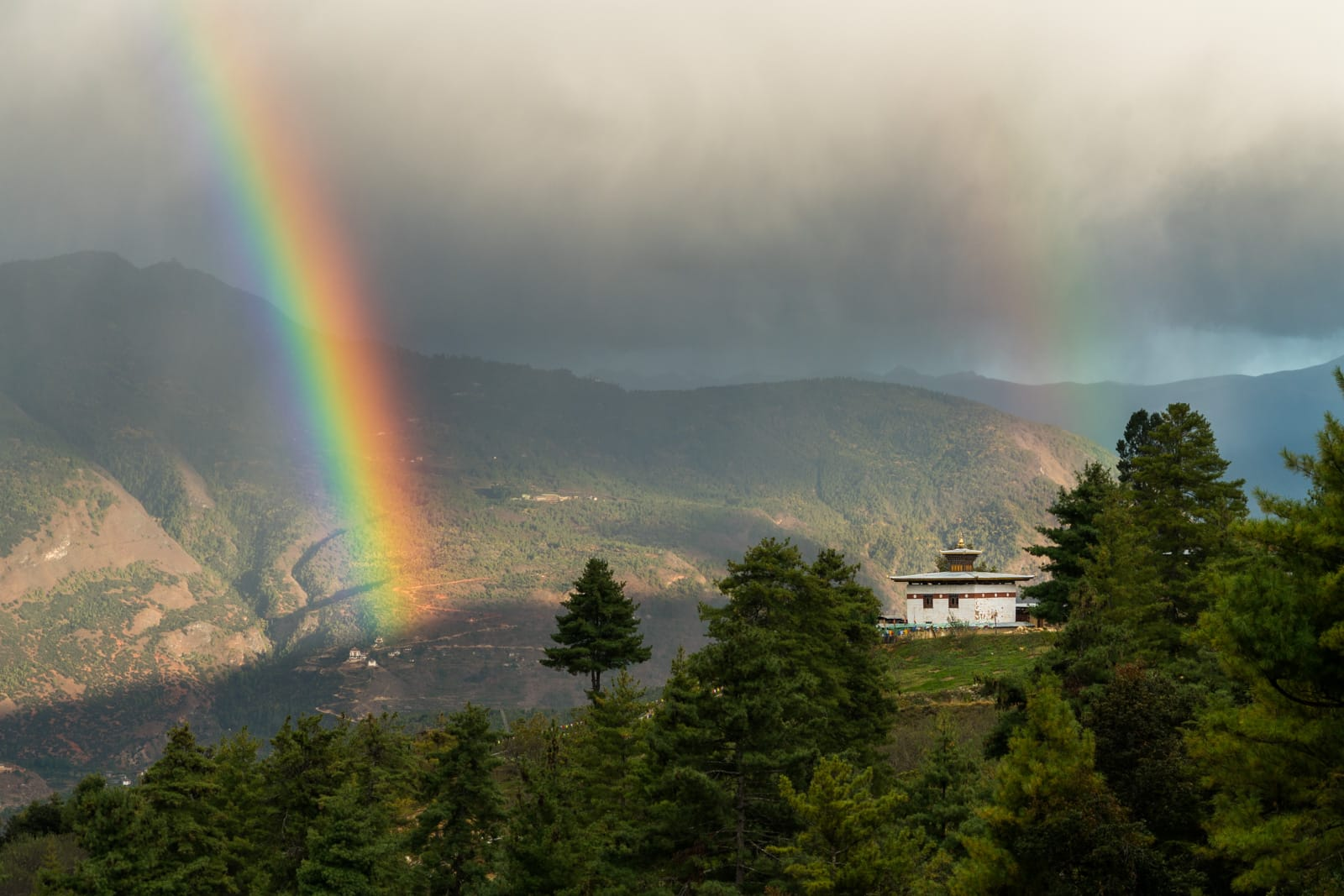 Photos of Bhutan - Double rainbow over a temple - Lost With Purpose travel blog
