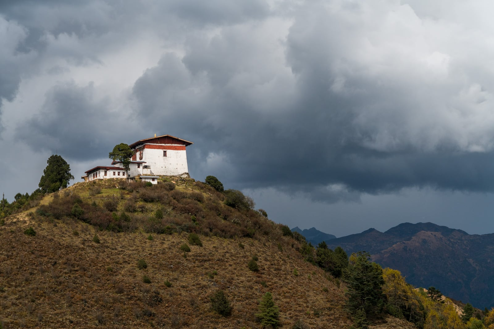 Photos of Bhutan - Storm clouds forming over Jele Dzong - Lost WIth Purpose travel blog