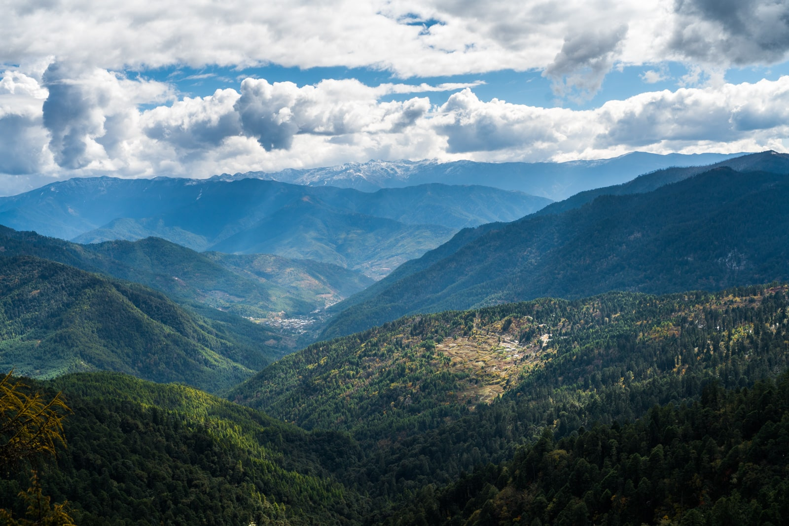 Stunning photos of Bhutan - Clouds over valley along the Druk Path between Thimphu and Paro - Lost With Purpose travel blog
