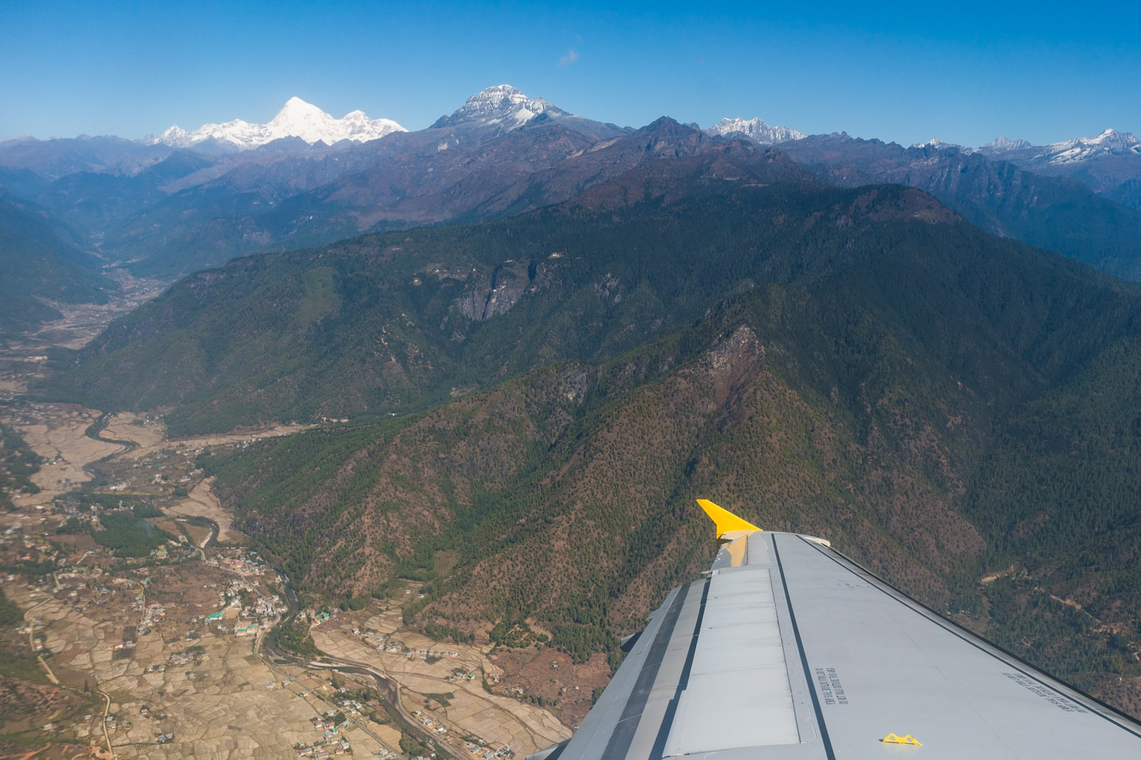 Photos of Bhutan - Plane wing while flying out of Paro - Lost With Purpose travel blog