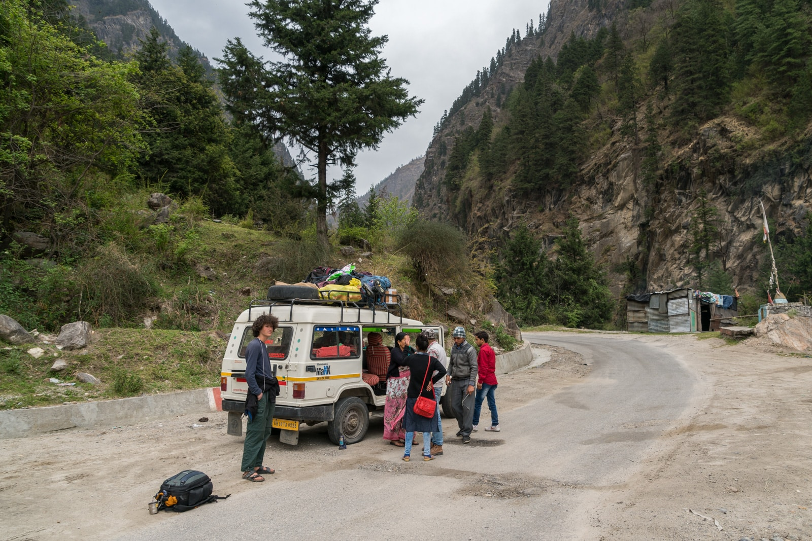 Guide to trekking to the start of the Ganges River in Uttarakhand, India - Flat tire stop on the shared Jeep ride to Gangotri - Lost With Purpose travel blog