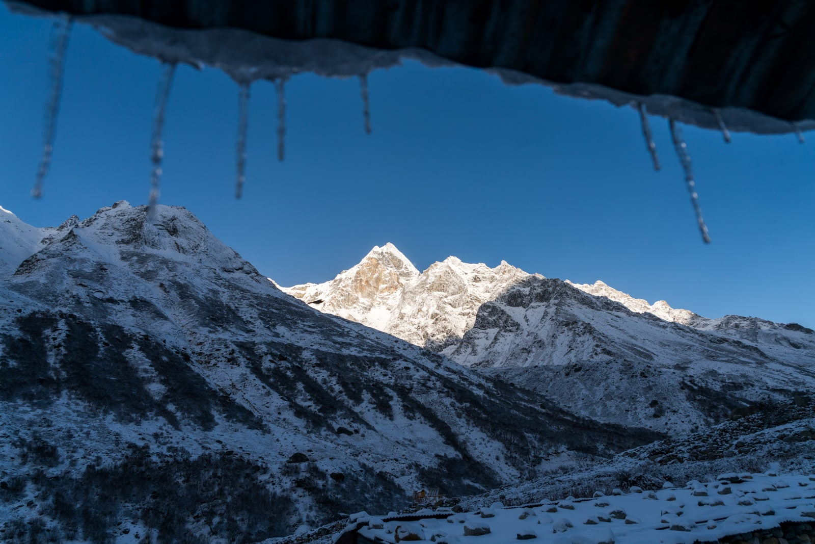 Guide to trekking to the start of the Ganges River in Uttarakhand, India - Icicles hanging from the roof of Lal Baba Ashram in Bhojwasa, Uttarakhand - Lost With Purpose travel blog