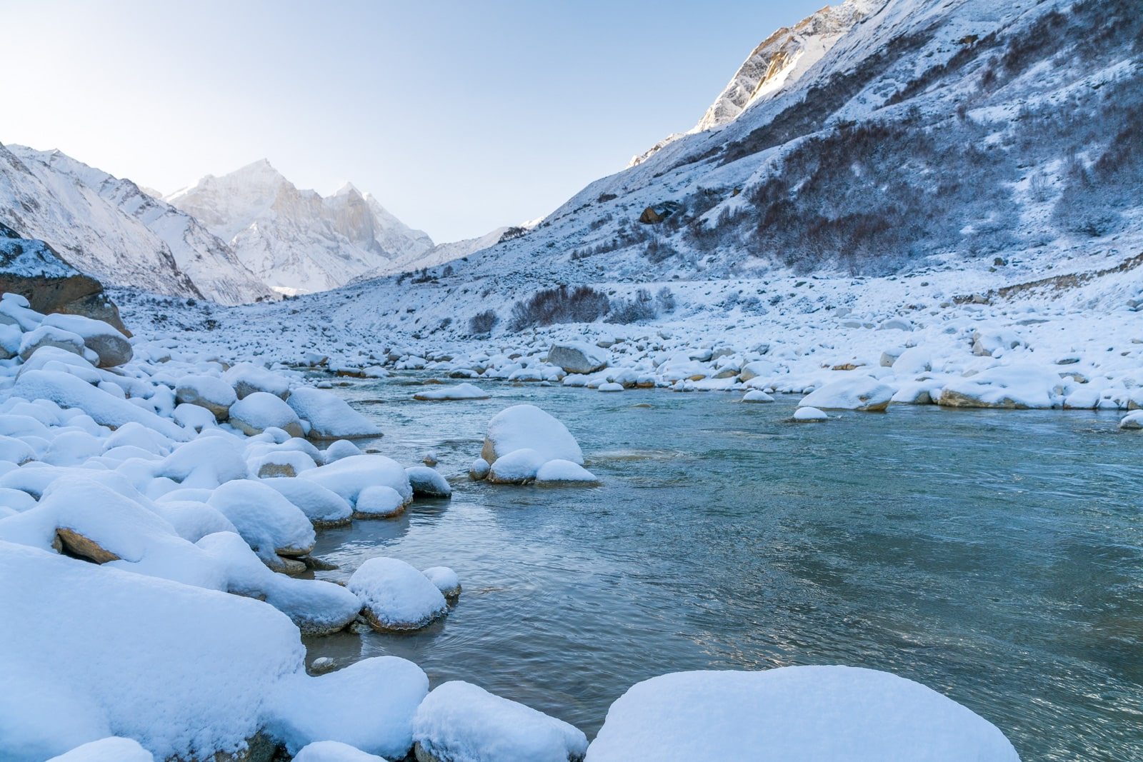 Trekking to the start of the Ganges River in Uttarakhand, India - Snowy sunrise in Bhojwasa with Bhagirathi River - Lost With Purpose travel blog