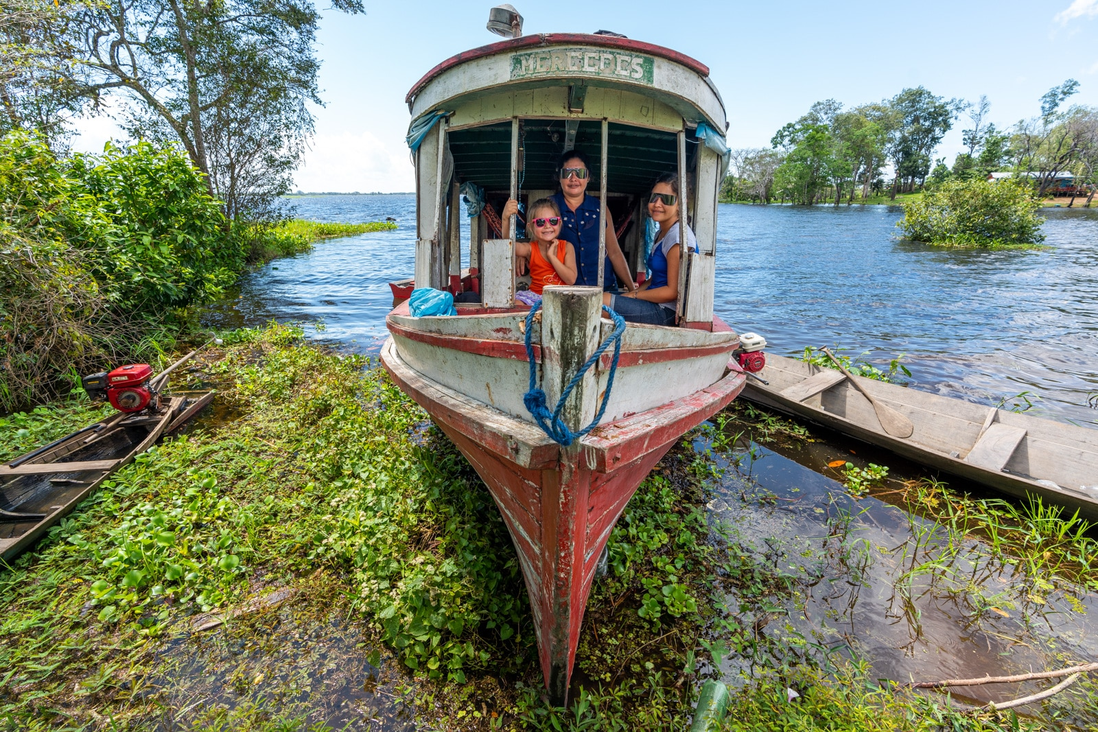OneSight's mobile eye care clinic in the Brazilian Amazon - Family of girls on a boat - Lost With Purpose travel blog