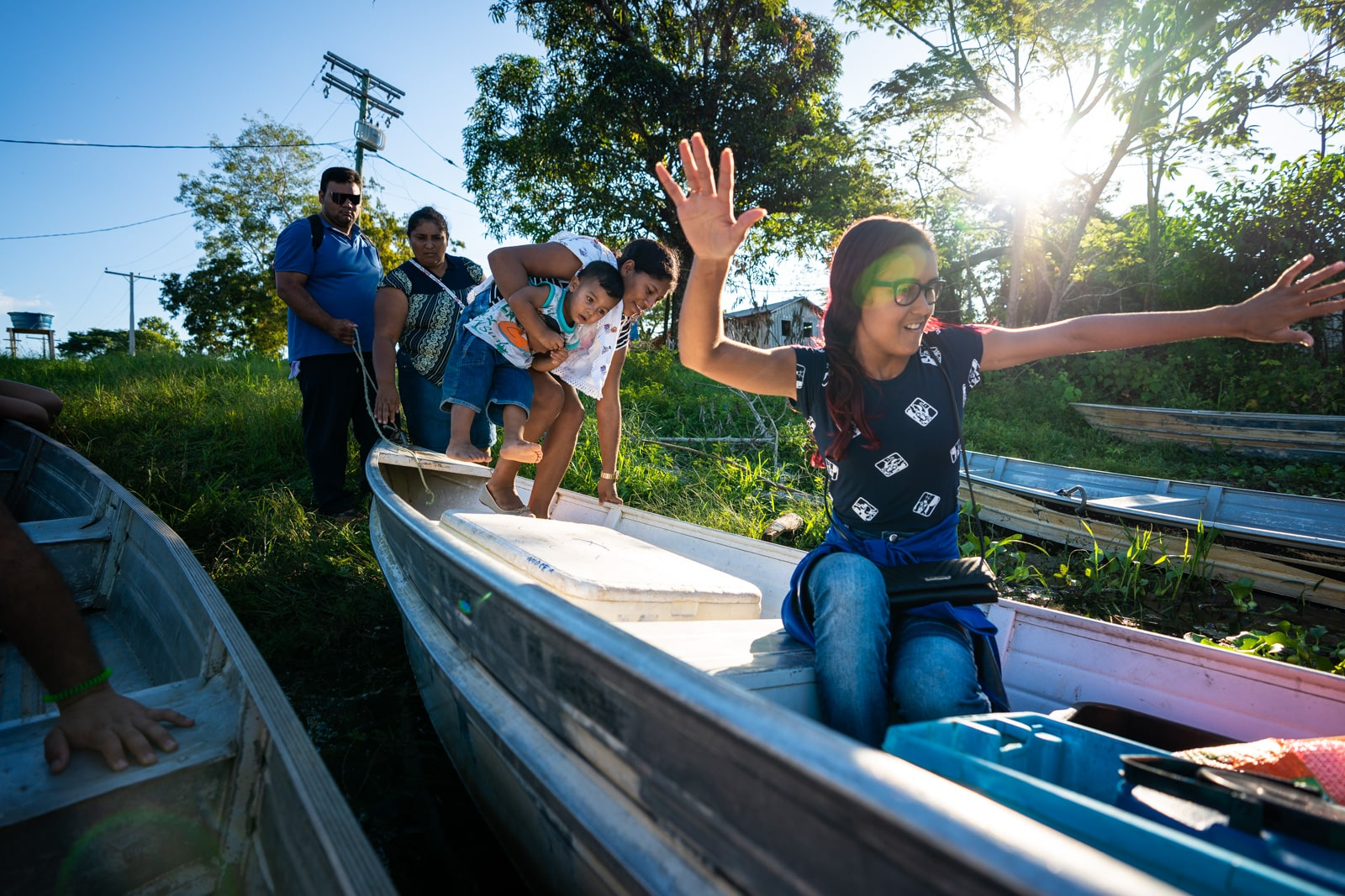 OneSight's mobile eye care clinic in the Brazilian Amazon - Family getting onto a boat to go home - Lost With Purpose travel blog