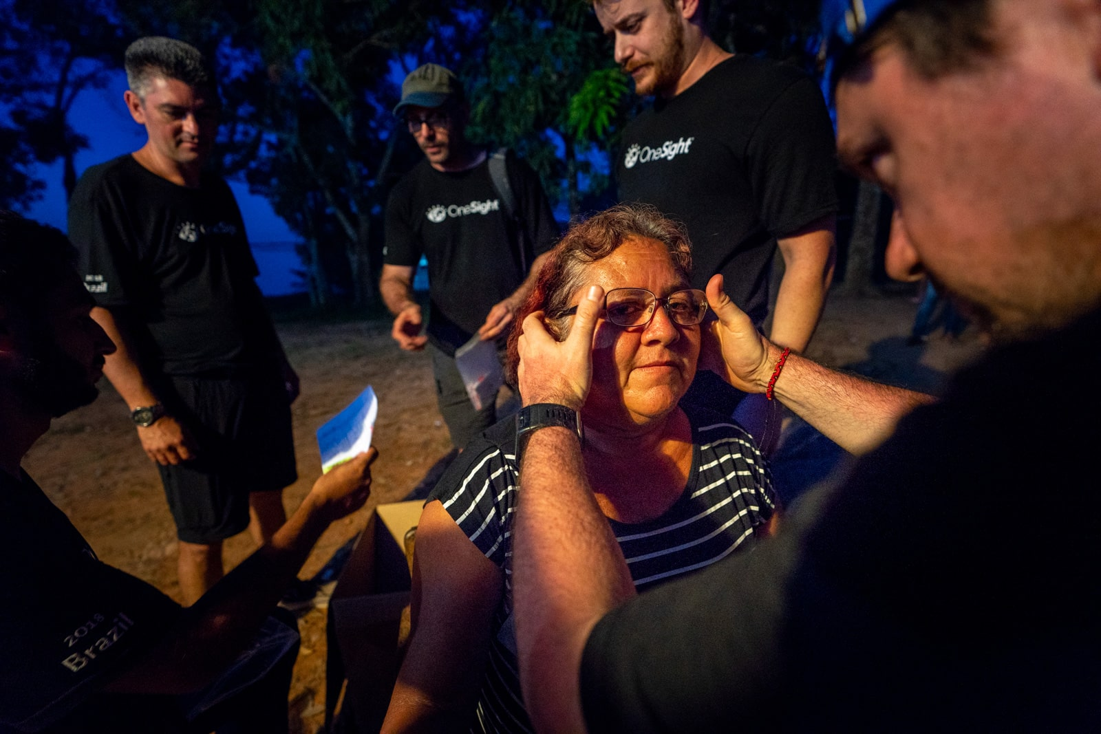 OneSight's mobile eye care clinic in the Brazilian Amazon - Marilucia receives her glasses - Lost With Purpose travel blog