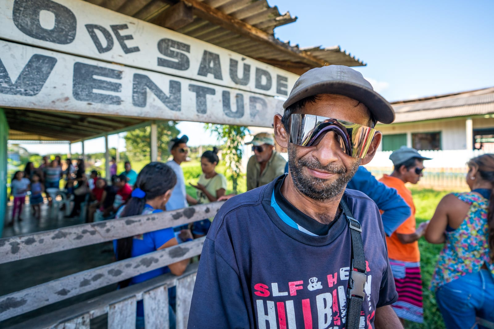 OneSight's mobile eye care clinic in the Brazilian Amazon - Alex the ice cream man with roll up sunglasses on - Lost With Purpose travel blog