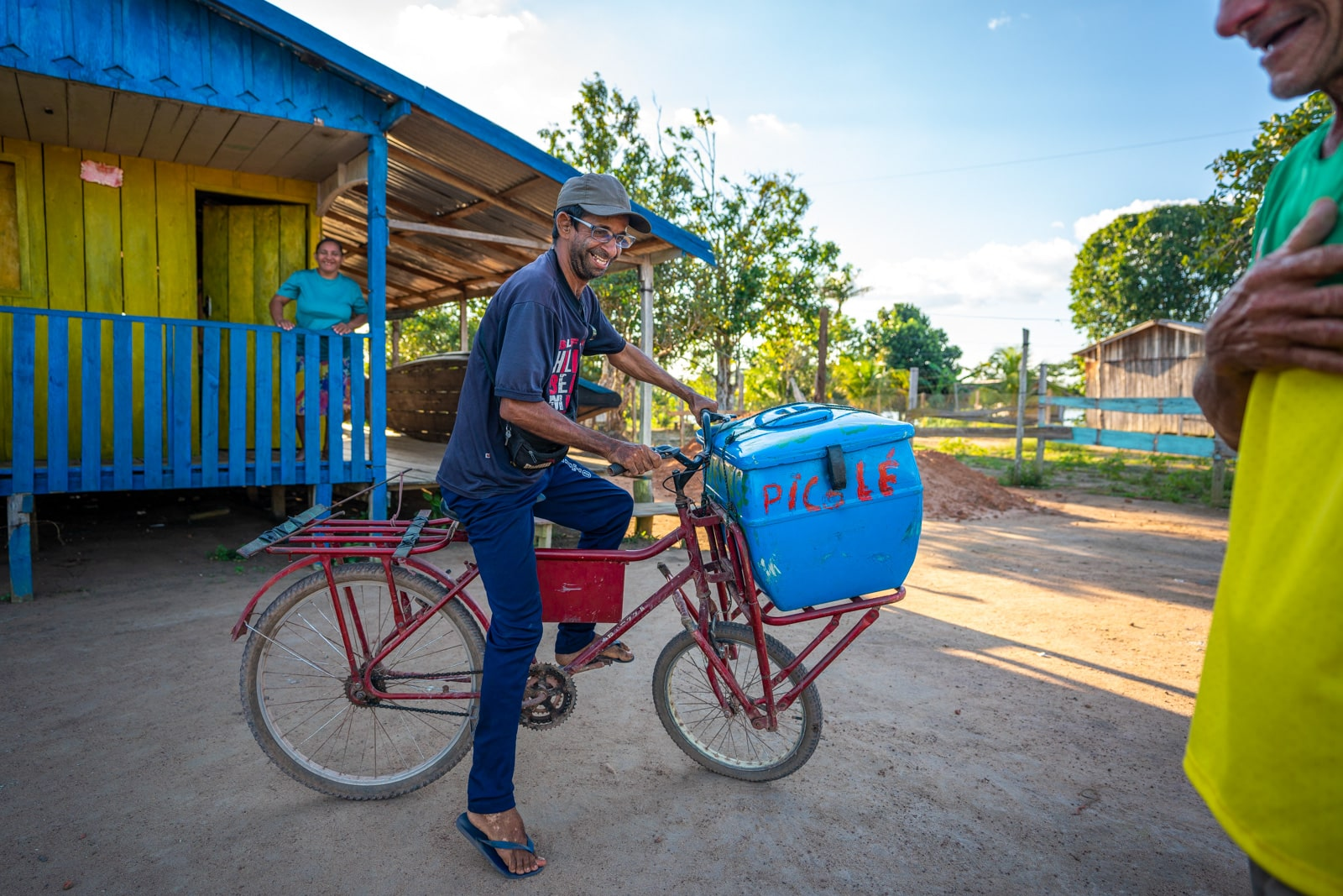 OneSight's mobile eye care clinic in the Brazilian Amazon - Alex the ice cream man on his bicycle - Lost With Purpose travel blog