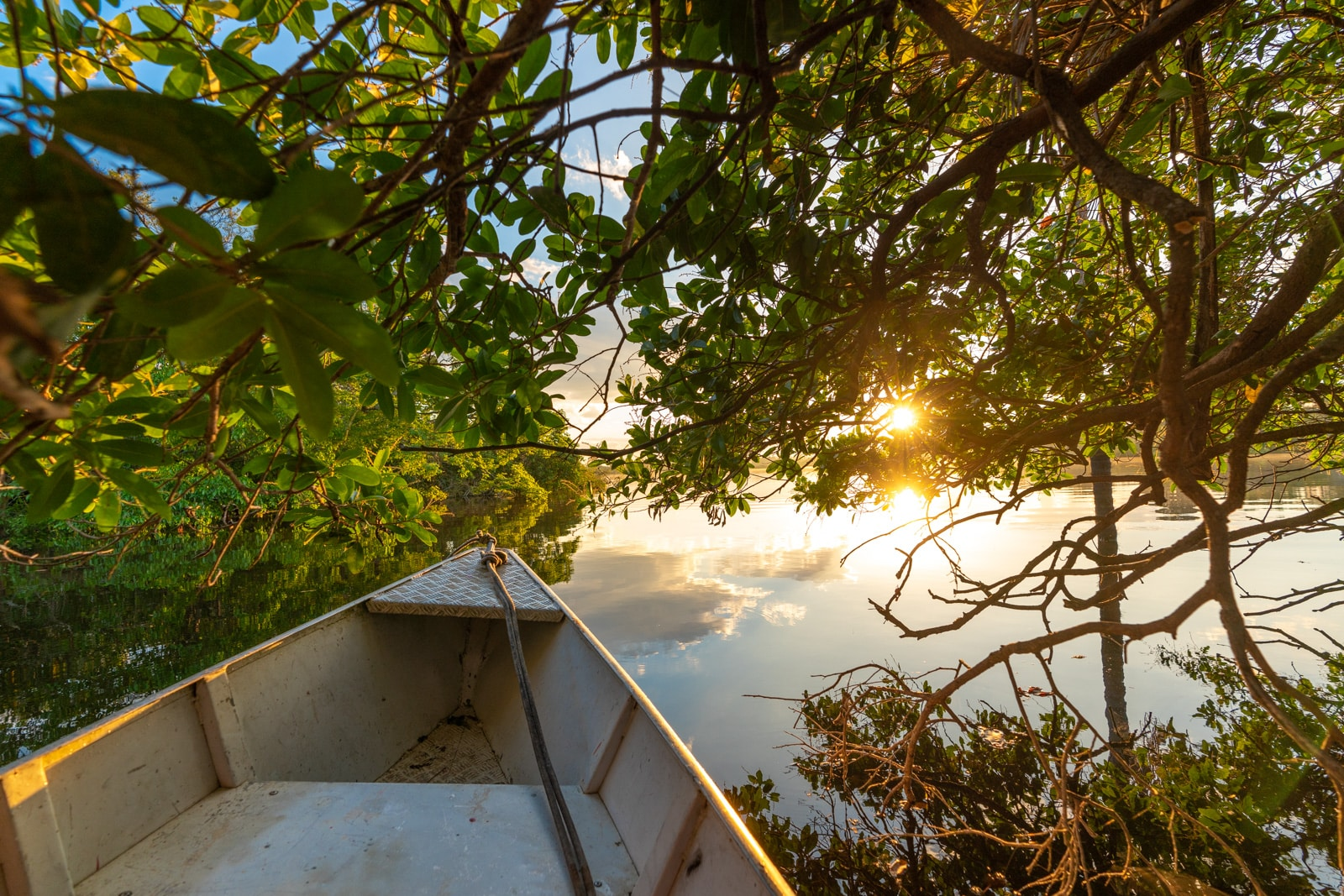 OneSight's mobile eye care clinic in the Brazilian Amazon - Boating on the Amazon River at sunrise - Lost With Purpose travel blog