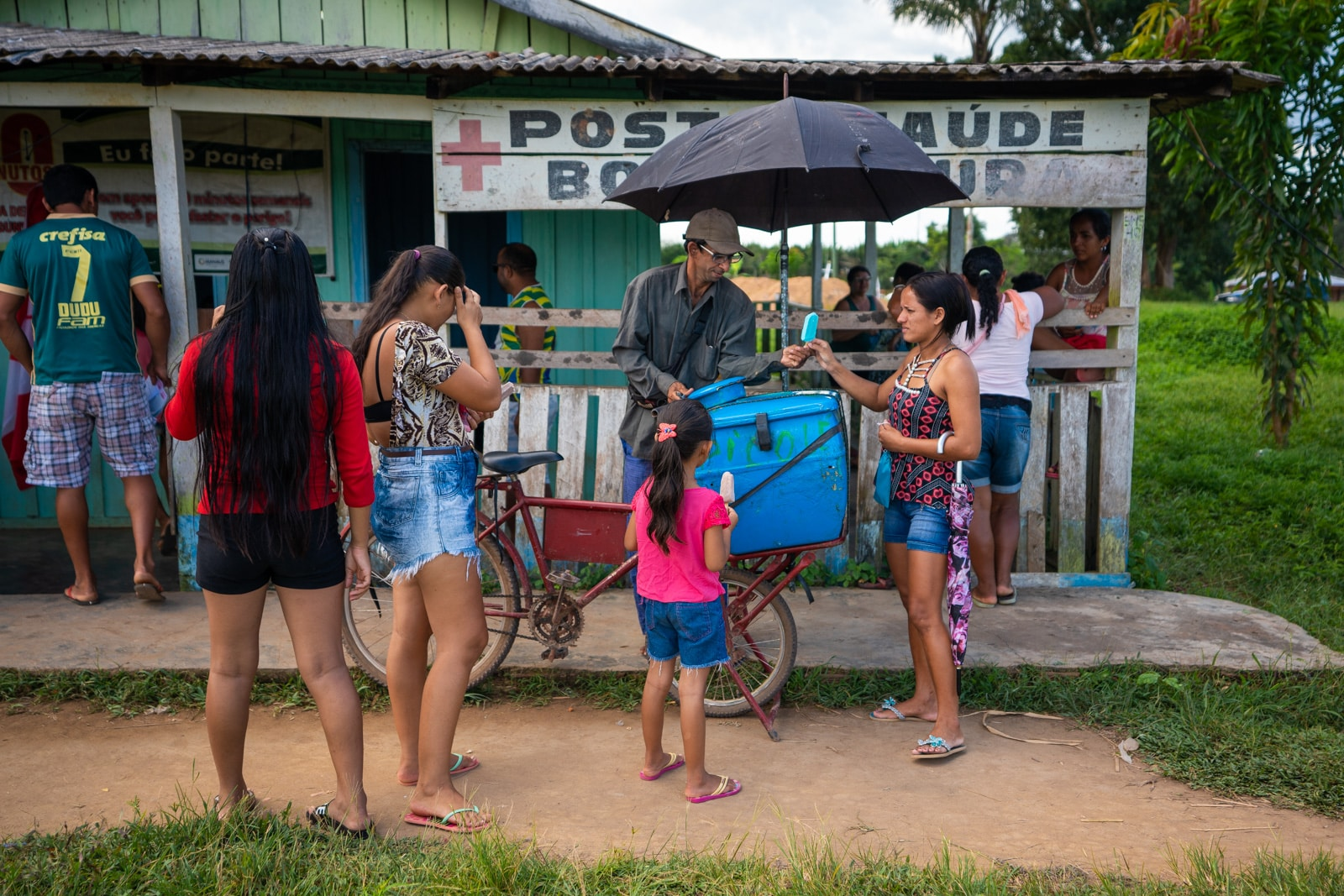 OneSight's mobile eye care clinic in the Brazilian Amazon - Alex selling popsicles - Lost With Purpose travel blog